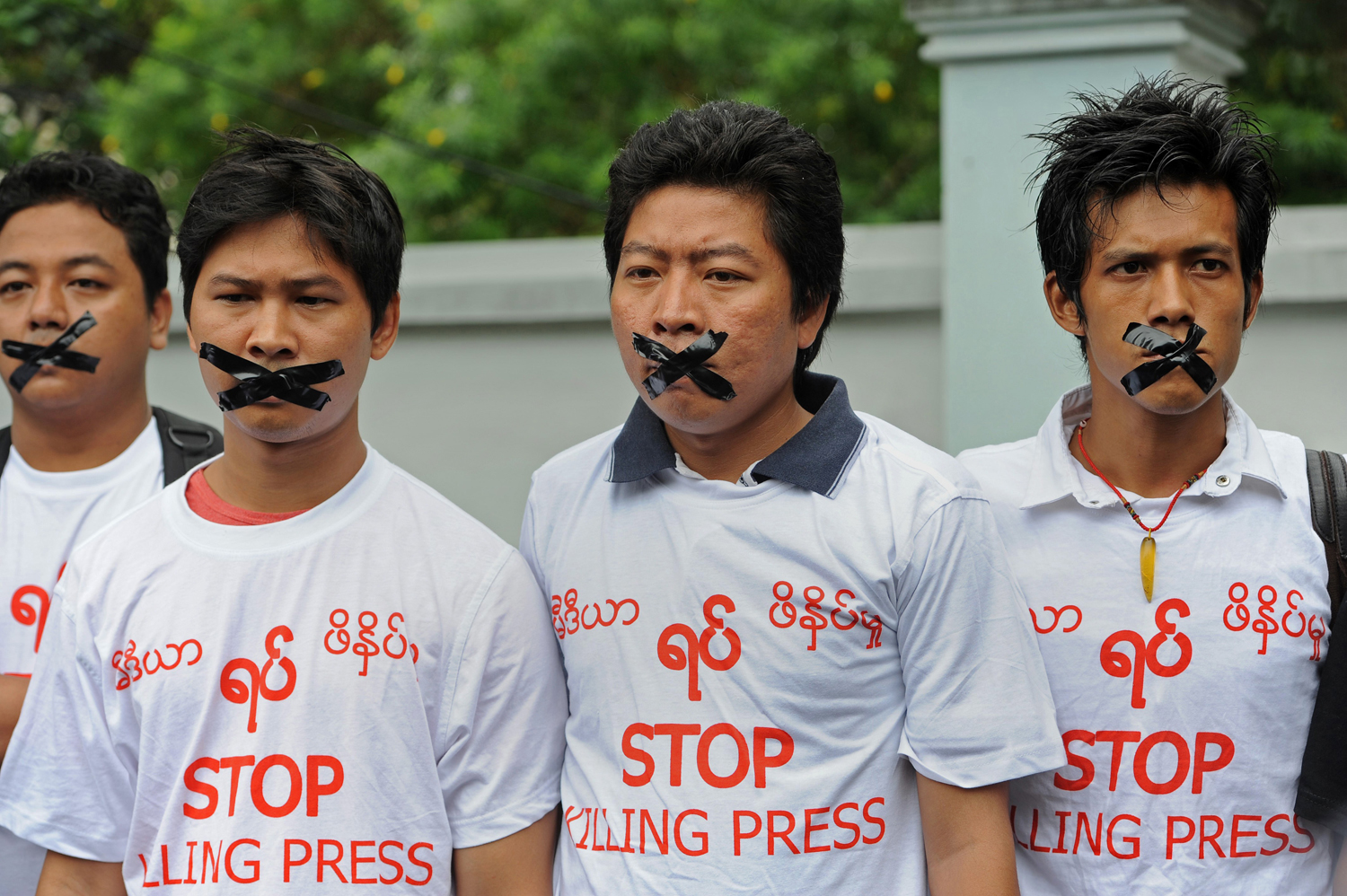 Burmese journalists wear T-shirts that say  Stop Killing Press  during a silent protest for five journalists who were jailed for 10 years on July 10, near the Myanmar Peace Center where Burmese President Thein Sein was scheduled to meet with local artists in Rangoon on July 12, 2014.