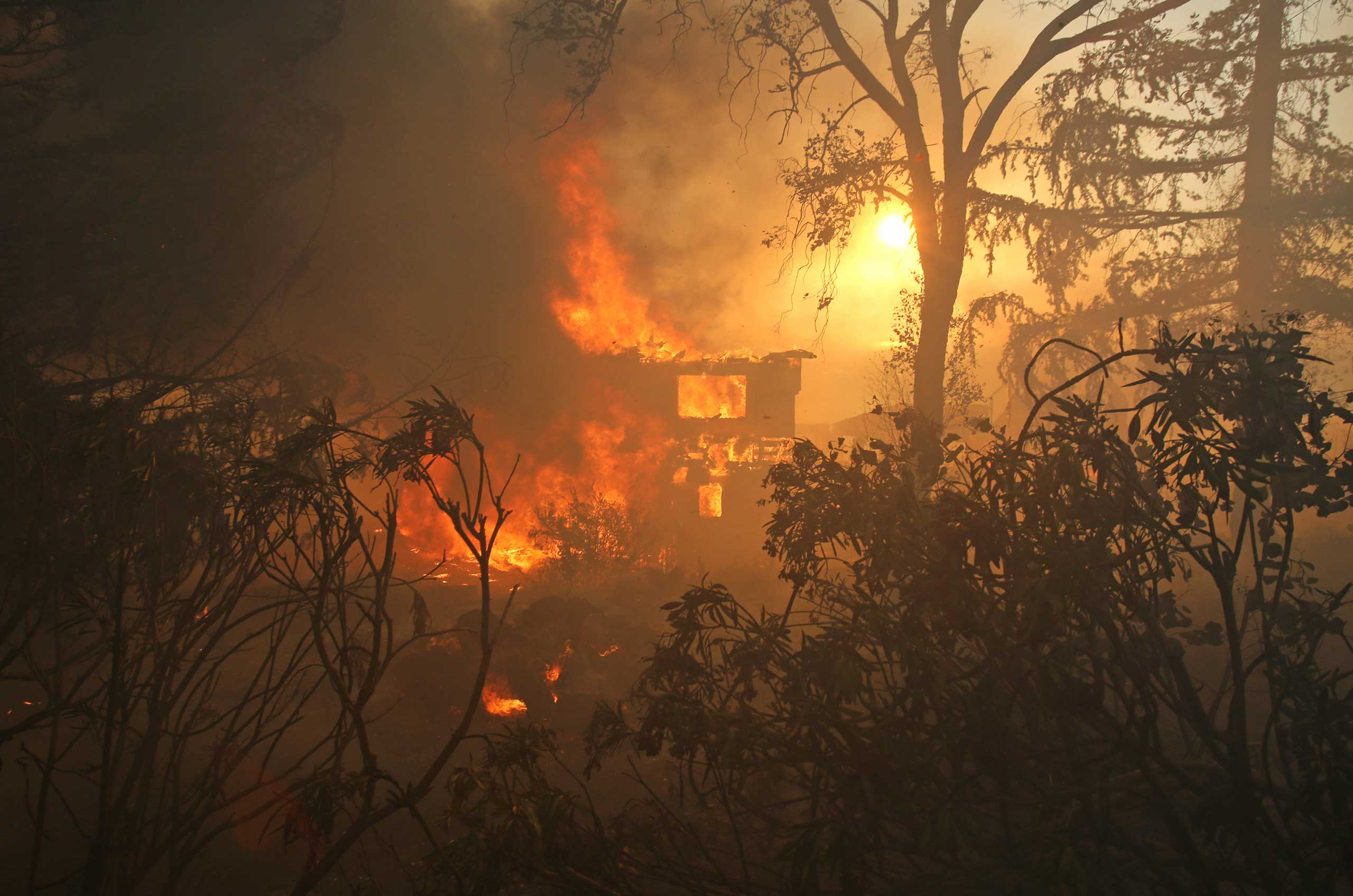 <b>Southern California Wildfires</b> A house is consumed by wildfire in San Marcos, Calif. on May 14, 2014. About 500 acres have burned in the San Marcos blaze, fueled by record heat, high winds and dry conditions. At least four other fires advanced in nearby communities.