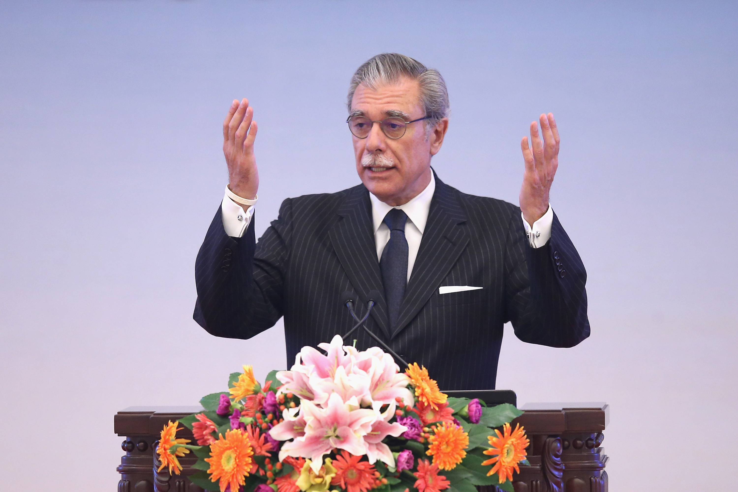 Former U.S. Secretary of Commerce Carlos Gutierrez gives a speech during the opening session of the 1st China Conference of Quality at The Great Hall Of The People on Sept. 15, 2014 in Beijing.