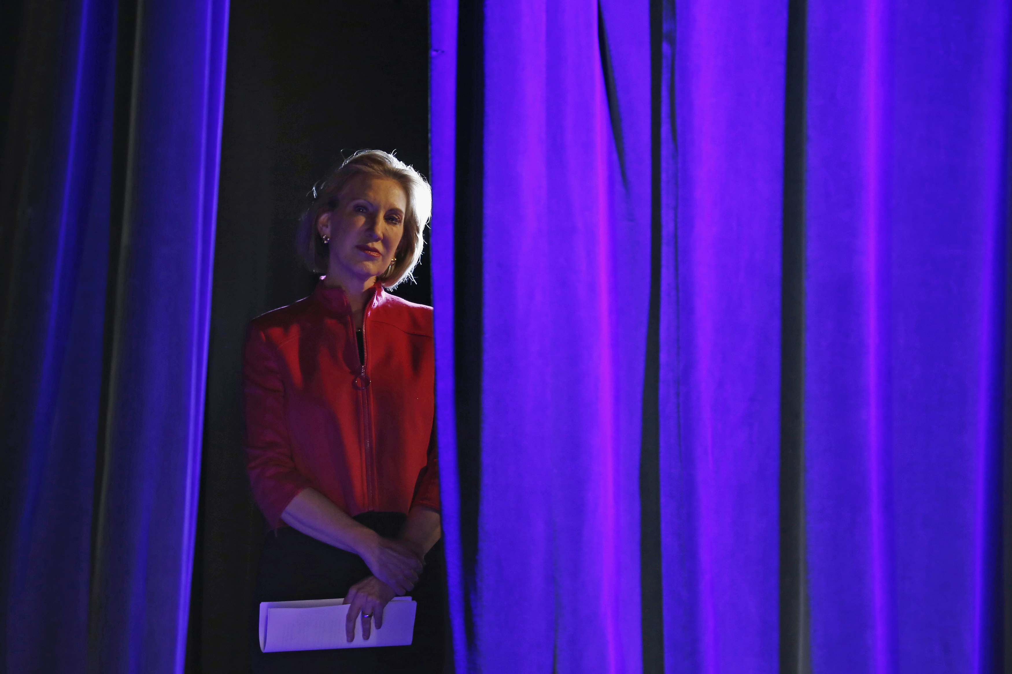 Former Hewlett-Packard Co Chief Executive Officer Carly Fiorina listens to her introduction from the side of the stage at the Freedom Summit in Des Moines, Iowa on Jan. 24, 2015.