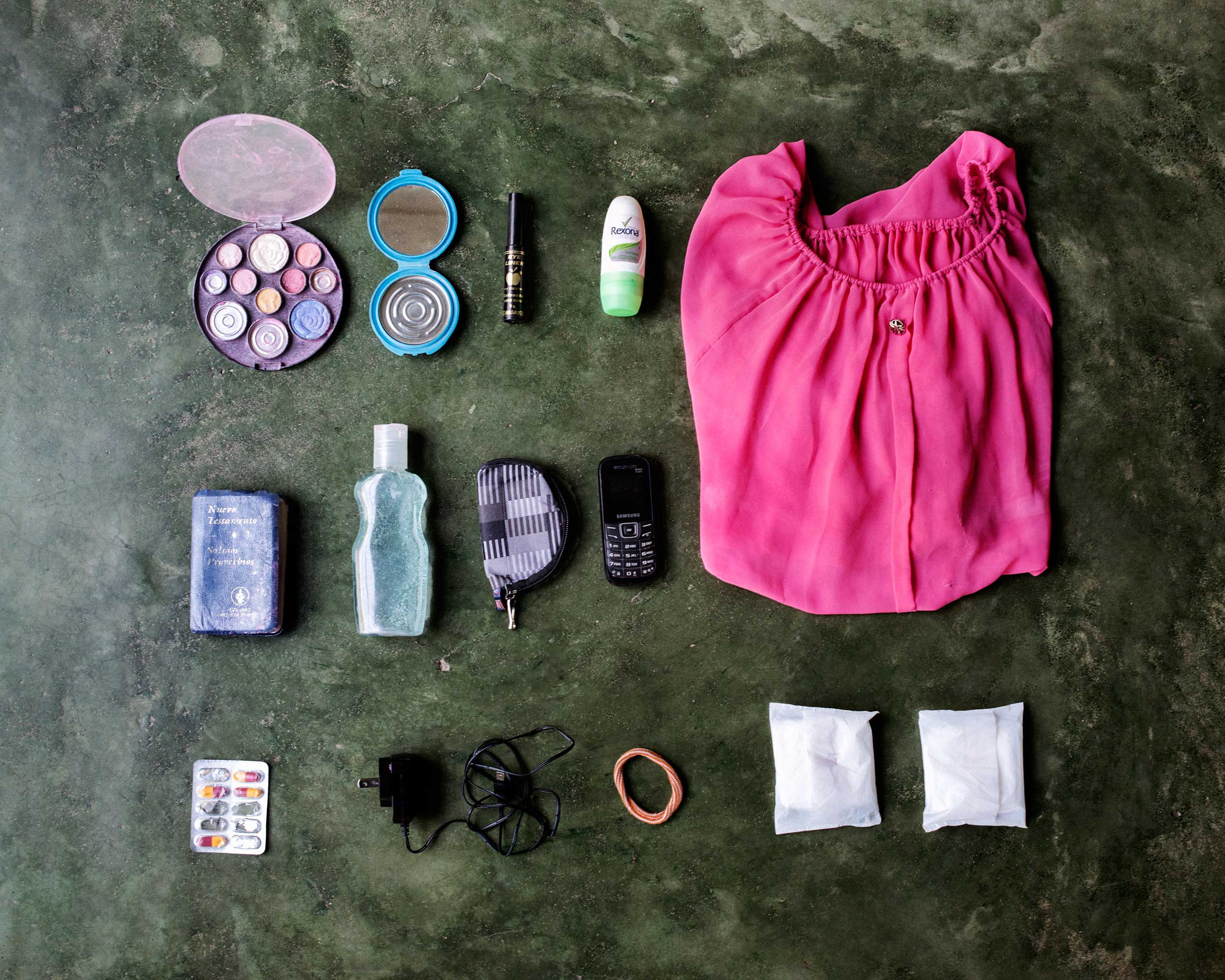 Delmis Helgar, 32, from Honduras. She is in a hurry to reach Houston where her little daughter is living with relatives, after her ex-husband was recently deported. In her bag was a make-up set, hand mirror, lip gloss, deodorant, a shirt, a small bible, face gel, a wallet, a cell phone, pills, a battery charger, hair band and two pantyliners.