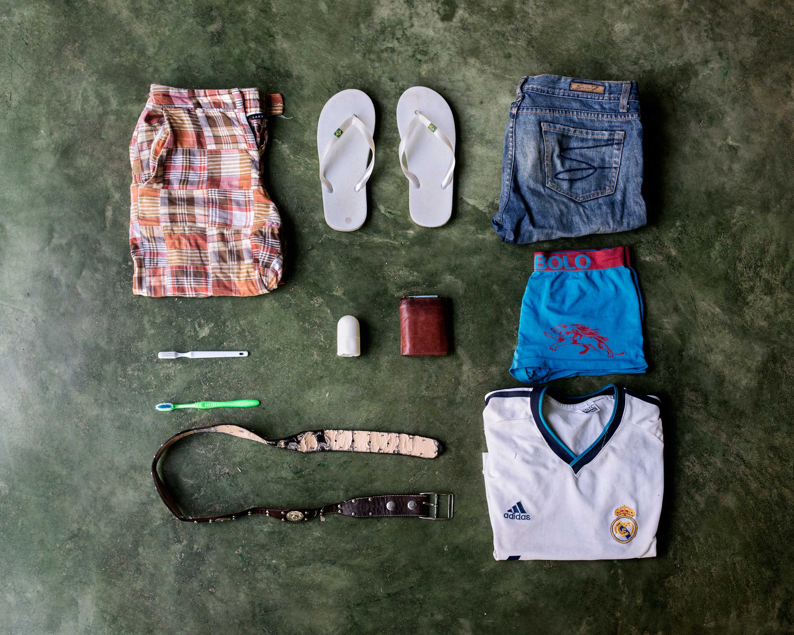 José Alfredo Bin, 27, from Guatemala. Deported from Mexico while he was trying to get to Miami, he wants to go to the U.S. to earn more money. In his bag, he has a pair of shorts, flip-flops, a pair of pants, two toothbrushes, deodorant, a wallet, underwear, a belt and a T-shirt of Real Madrid.