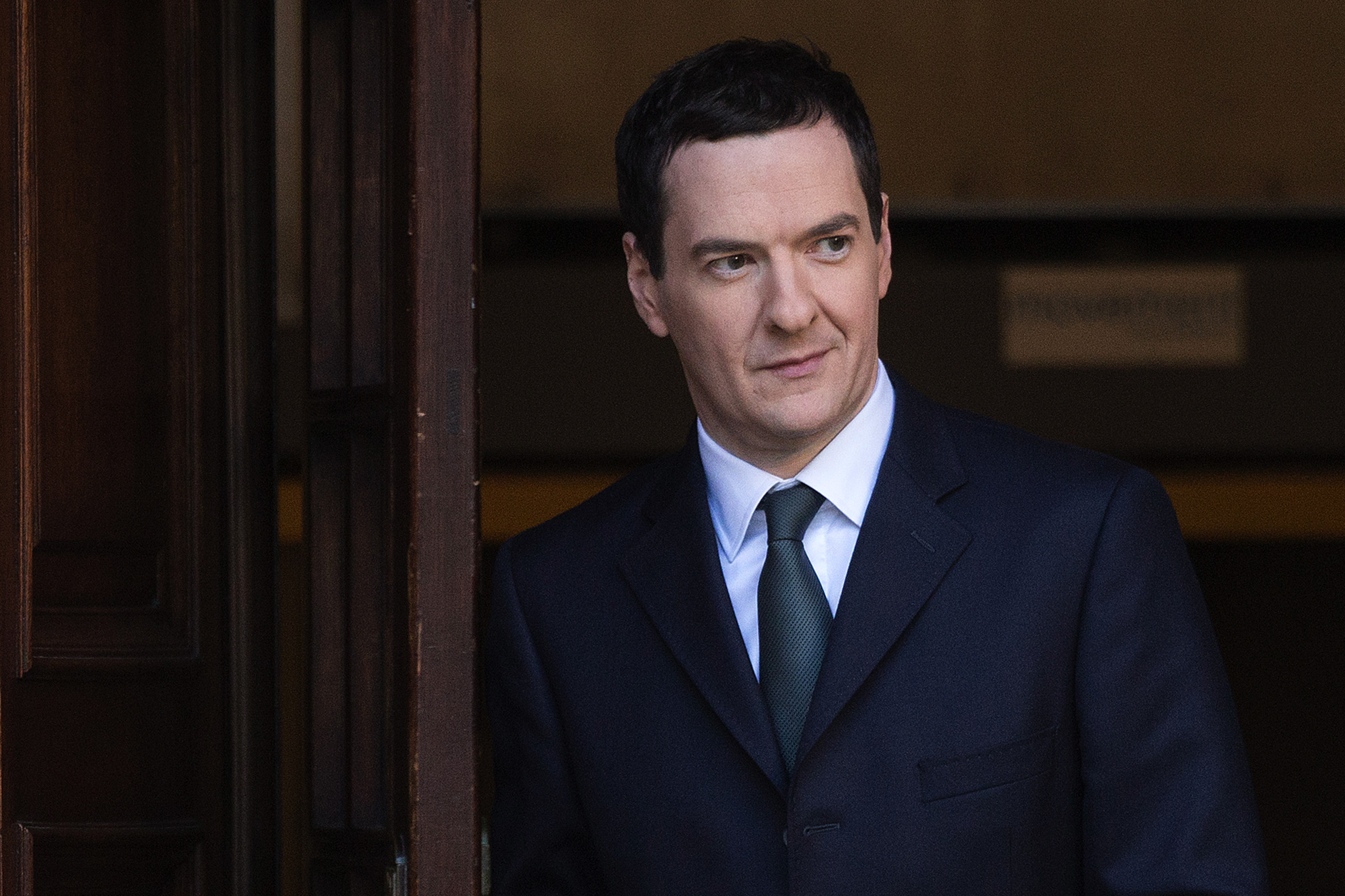 George Osborne U.K. chancellor of the exchequer leaves the HM Treasury building before heading to the Houses of Parliament to deliver his Autumn statement in London on Dec. 3, 2014.