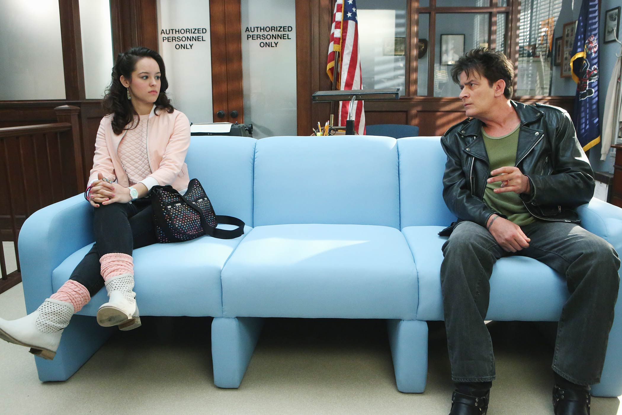 Hayley Orrantia as Erica Goldberg and Charlie Sheen as  Boy in the Police Station  on The Goldbergs.
