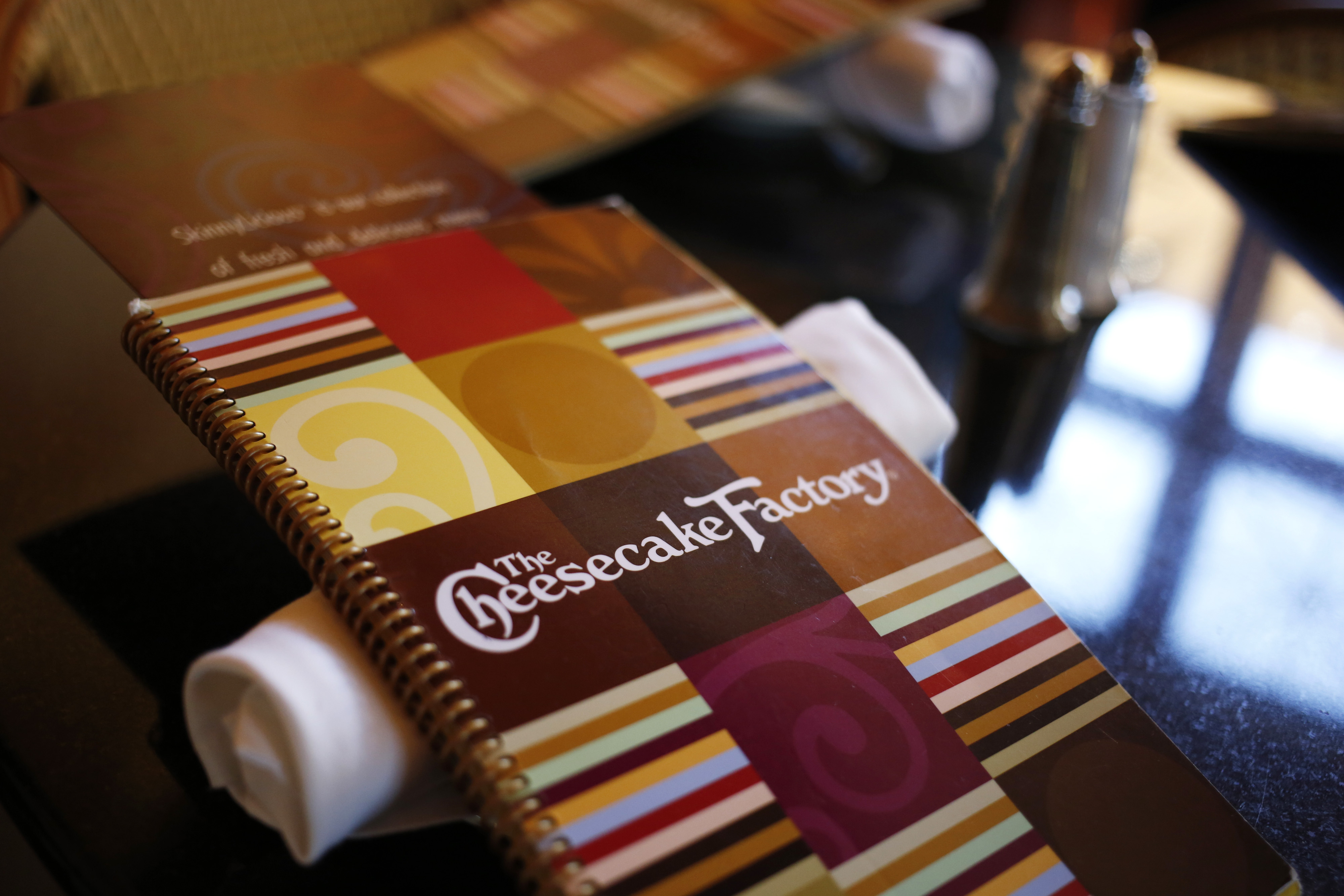 A menu sits on a table at a Cheesecake Factory restaurant in Louisville, Kentucky on Nov. 13, 2013.