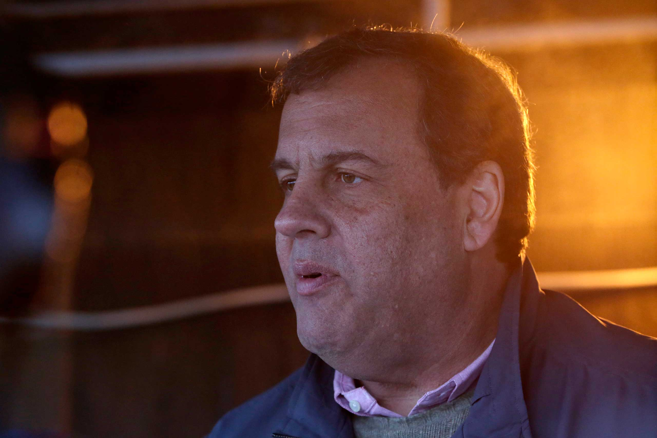 New Jersey Gov. Chris Christie hands at the St. John's Church soup kitchen on Nov. 26, 2014, in Newark, N.J.