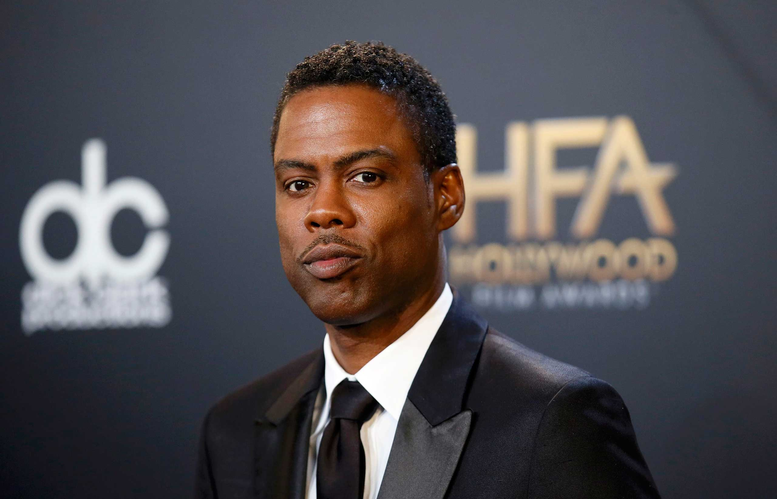 Actor Chris Rock poses backstage during the Hollywood Film Awards in Hollywood, Calif. on  Nov. 14, 2014.