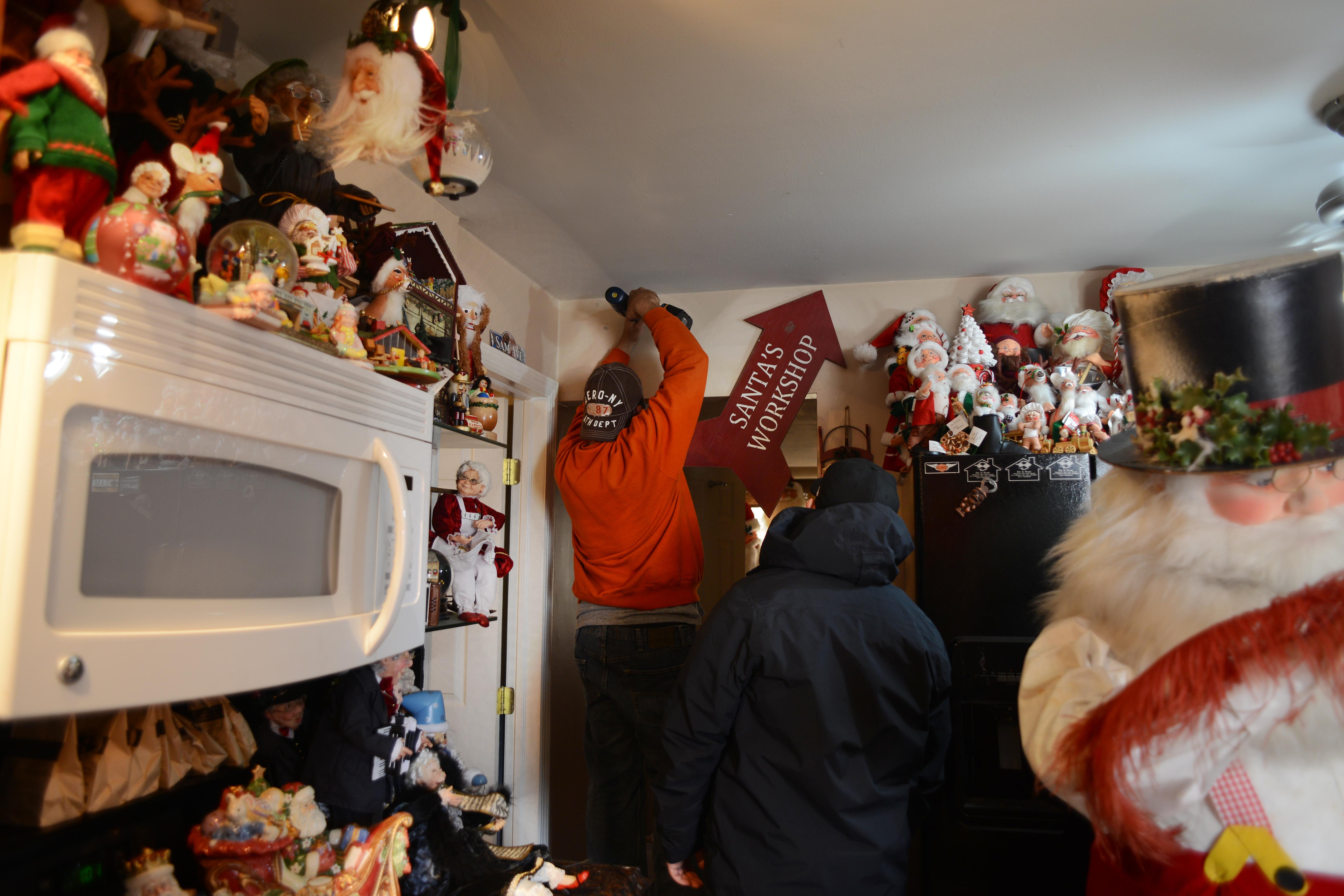 Ray helps Sammy install Christmas decorations.