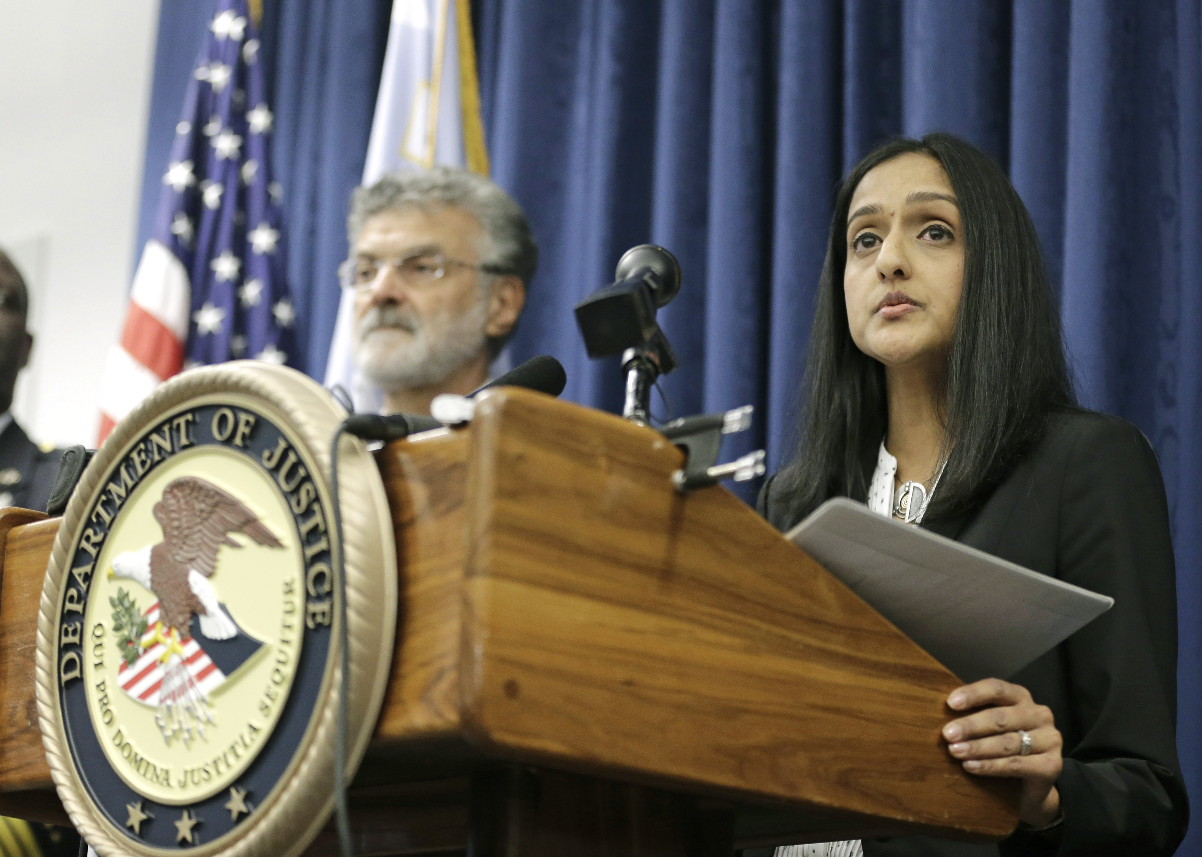 U.S. Acting Assistant Attorney General Vanita Gupta for the Civil Rights Division, right, makes a statement during a news conference on Dec. 4, 2014, in Cleveland.