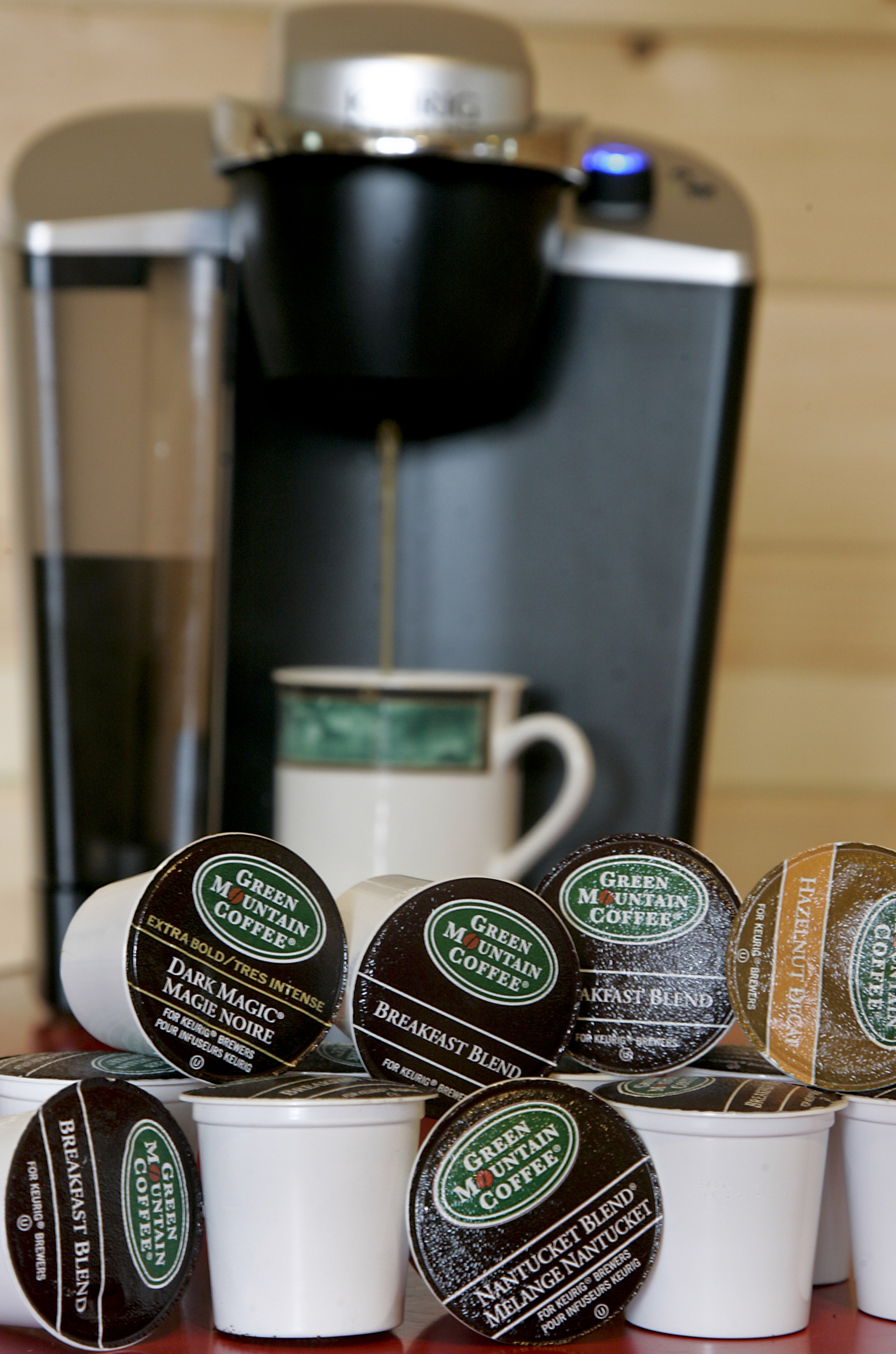 A coffee maker made by Keurig, a unit of Green Mountain Coffee Roasters Inc. K-Cups are arranged for a photo in Waterbury, Vt, on July 19, 2010.