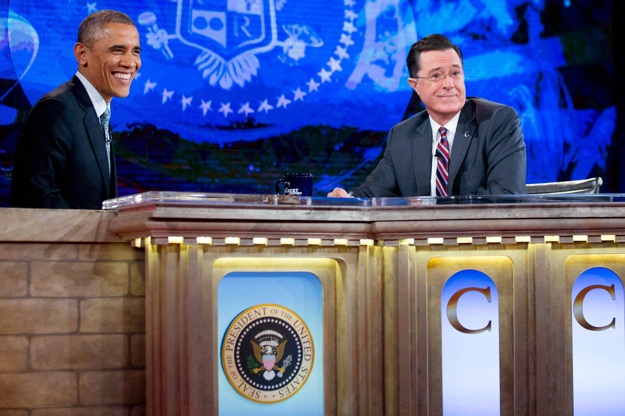 President Barack Obama talks to Stephen Colbert during a taping of The Colbert Report in Lisner Auditorium at George Washington University on Dec. 8, 2014 in Washington, DC.