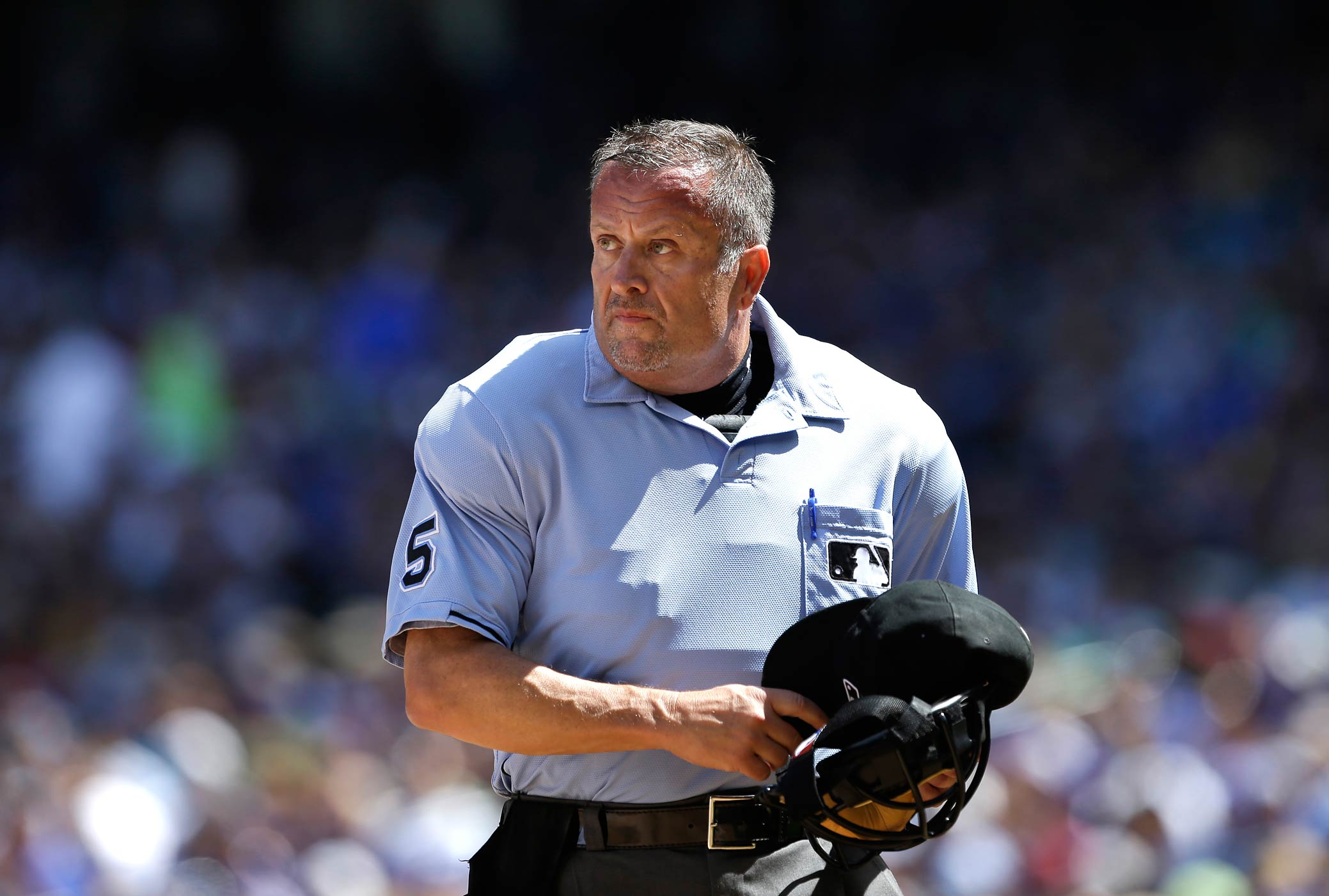 Umpire Dale Scott officiates a game between the Mariners and Toronto Blue Jays on Aug. 7, 2013, in Seattle, Wa.