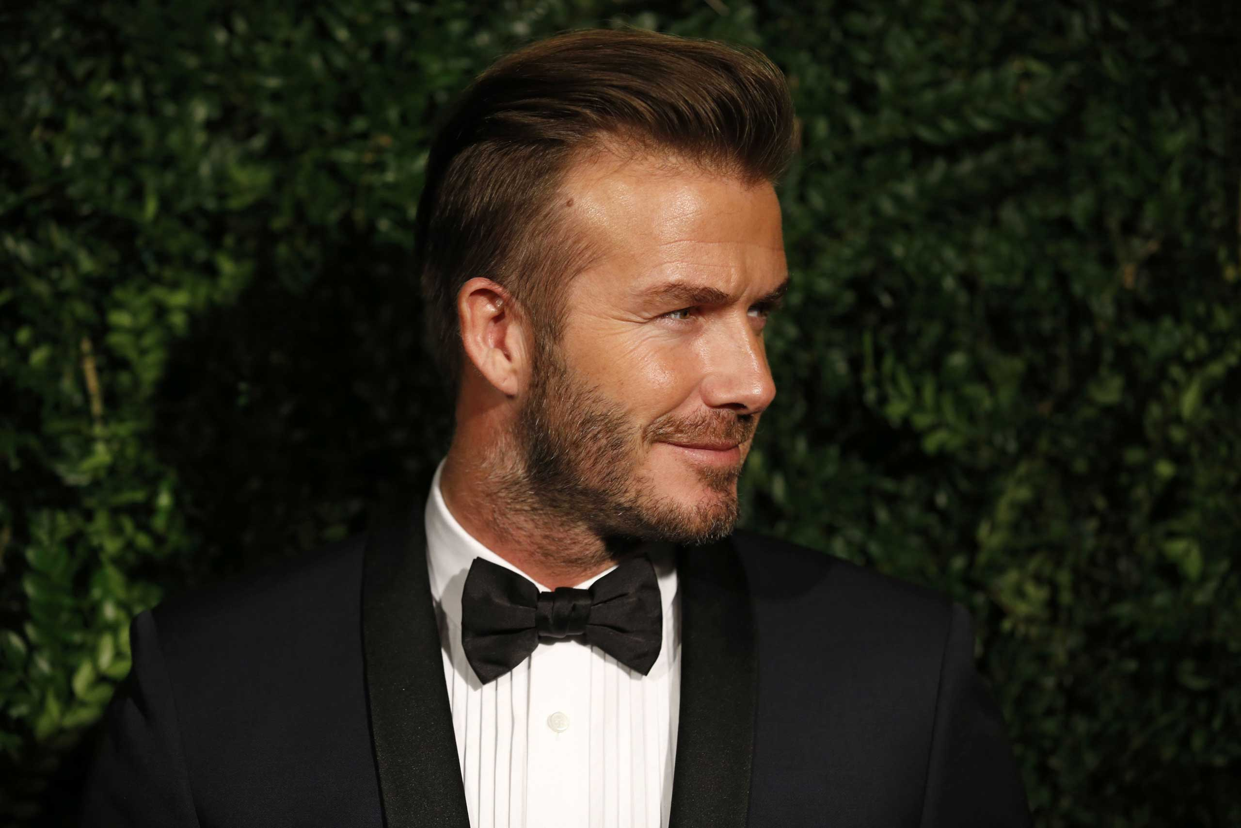 David Beckham poses on the red carpet as he attends the 60th London Evening Standard Theatre Awards 2014 in London on Nov. 30, 2014.