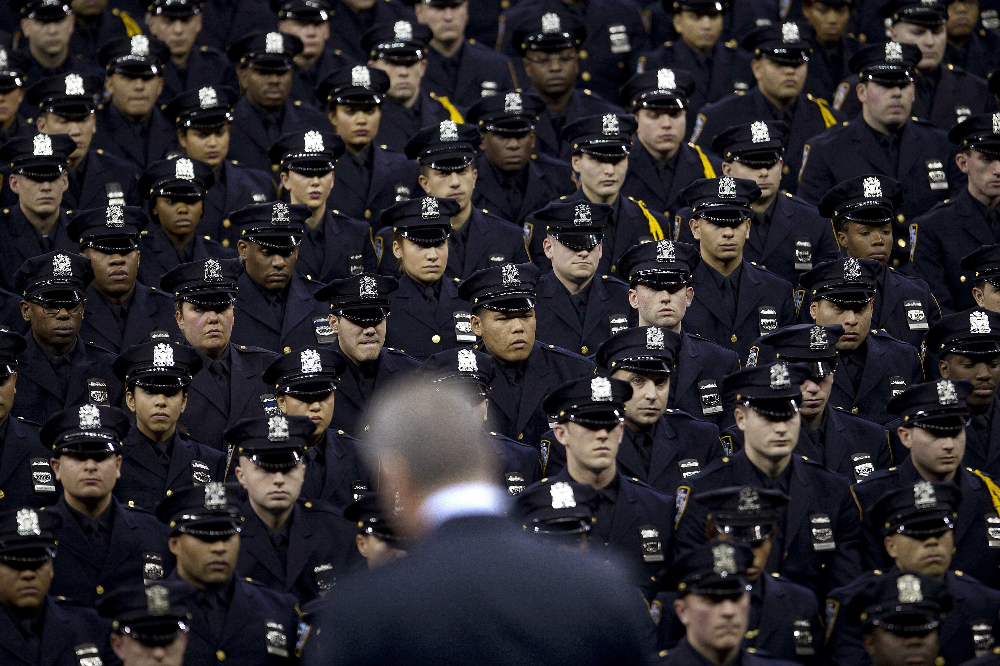 New York Mayor Bill de Blasio speaks from the podium to the New York City Police Academy Graduating class in New Yorkon Dec. 29, 2014.