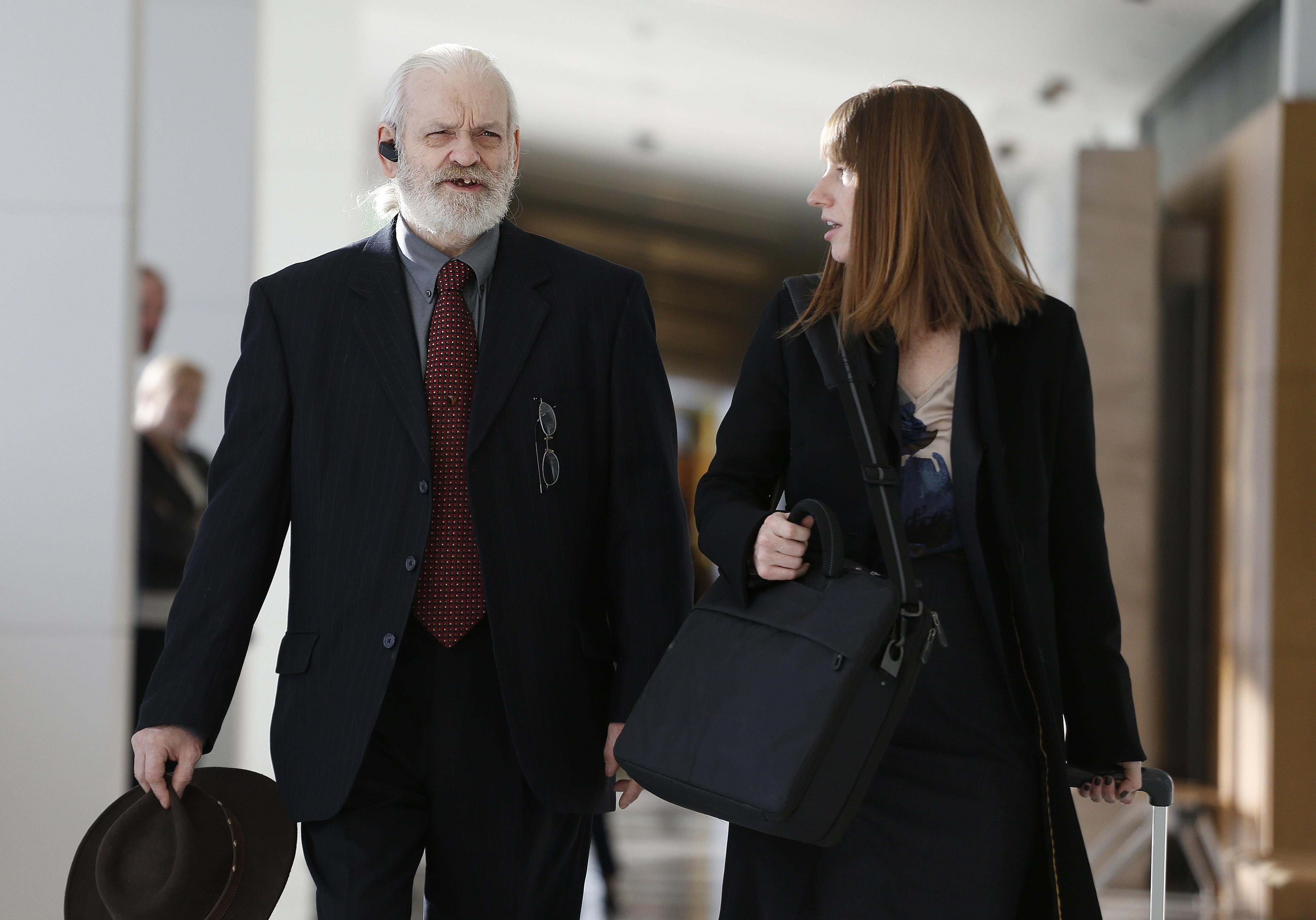 In this Nov. 15, 2013 file photo, Wayne Sperling, left, arrives at court with his public defender at the Denver Justice Center, in Denver.