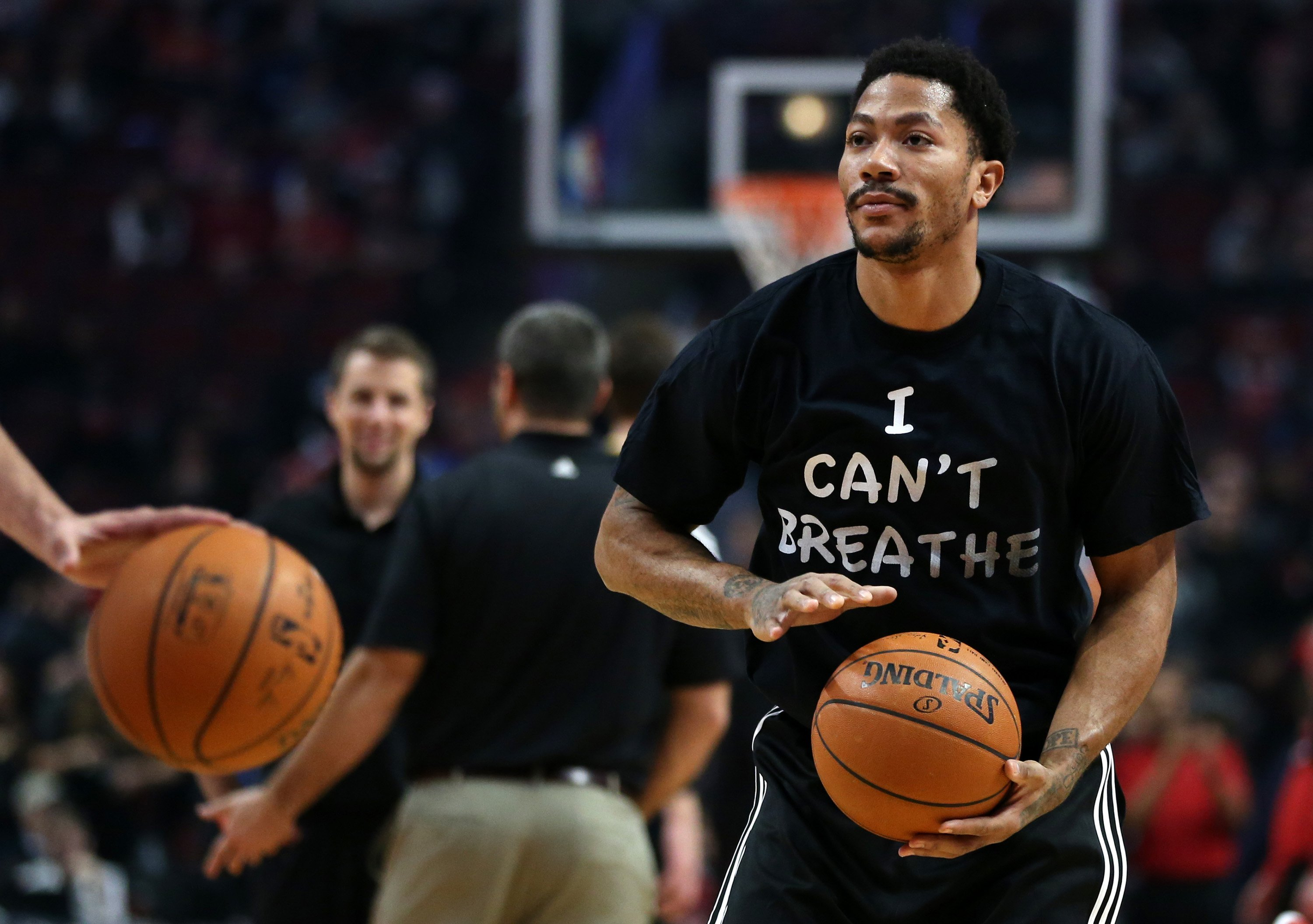 Chicago Bulls guard Derrick Rose wears a shirt reading  I Can't Breath  while warming up for a game against the Golden State Warriors on Dec. 6, 2014 at the United Center in Chicago.