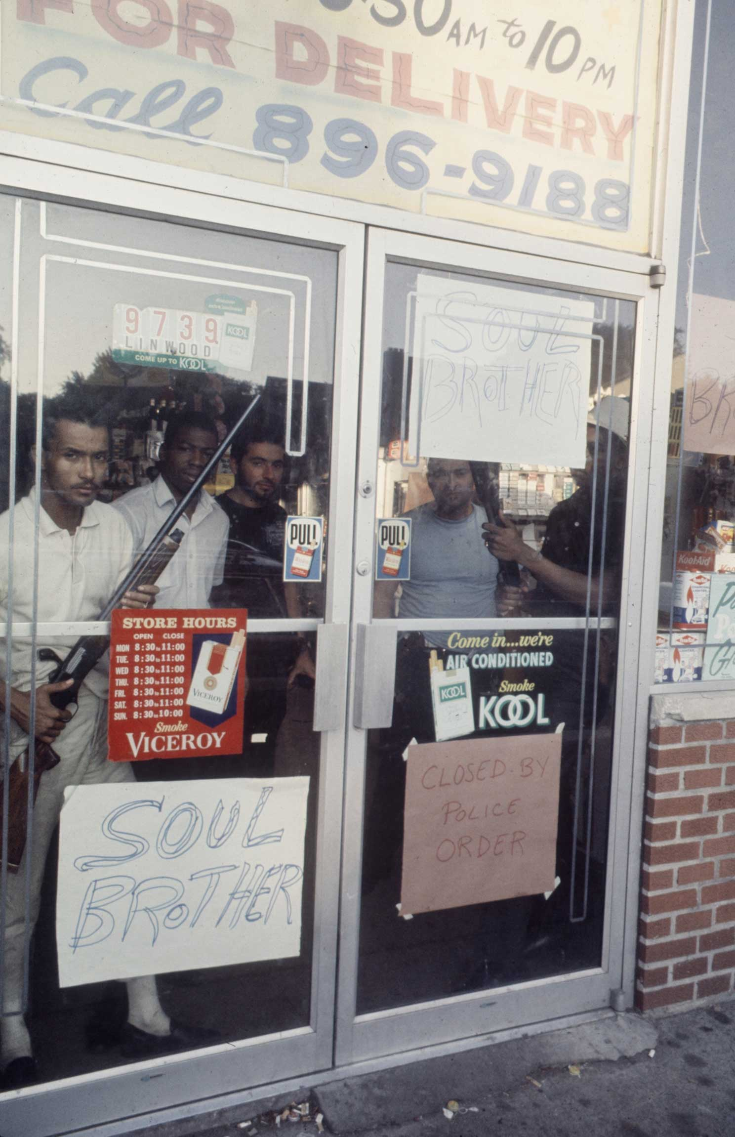 """<b>Caption from LIFE.</b> """"Determined to protect their own property at any cost, both Negro and white store owners brought out weapons and stood ready to use them."""""""