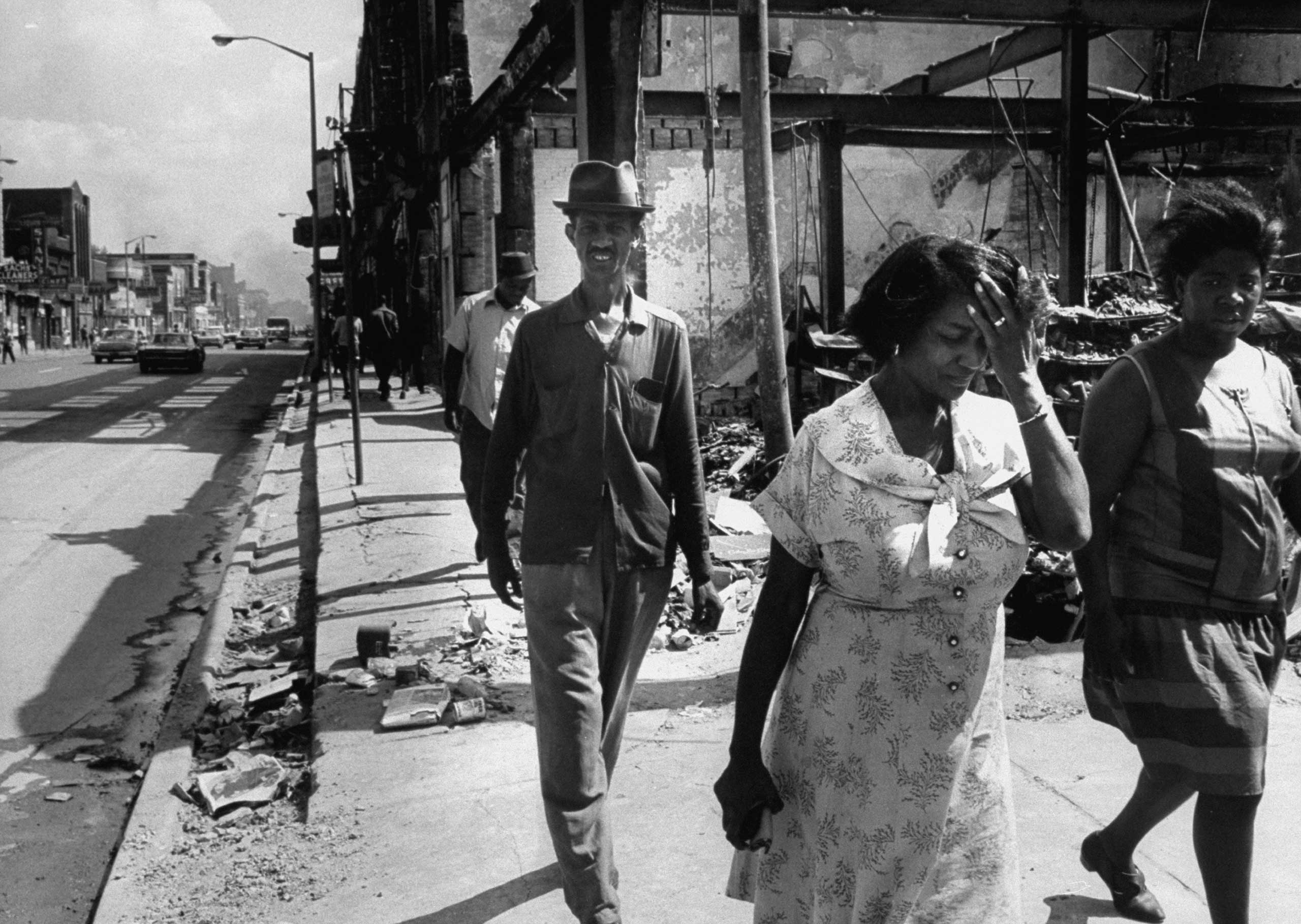 <b>Not published in LIFE.</b> Detroit, July 1967. A family takes a walk in a neighborhood devastated by rioting.