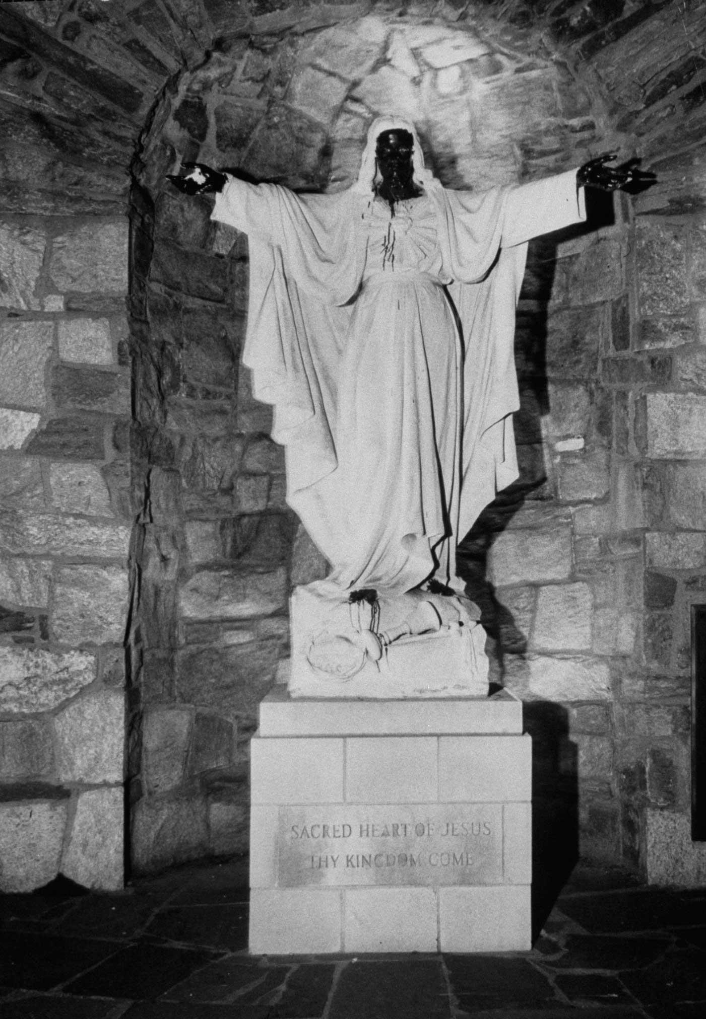 <b>Not published in LIFE.</b> Detroit, July 1967. Statue of Jesus Christ smeared with brown paint during riots.