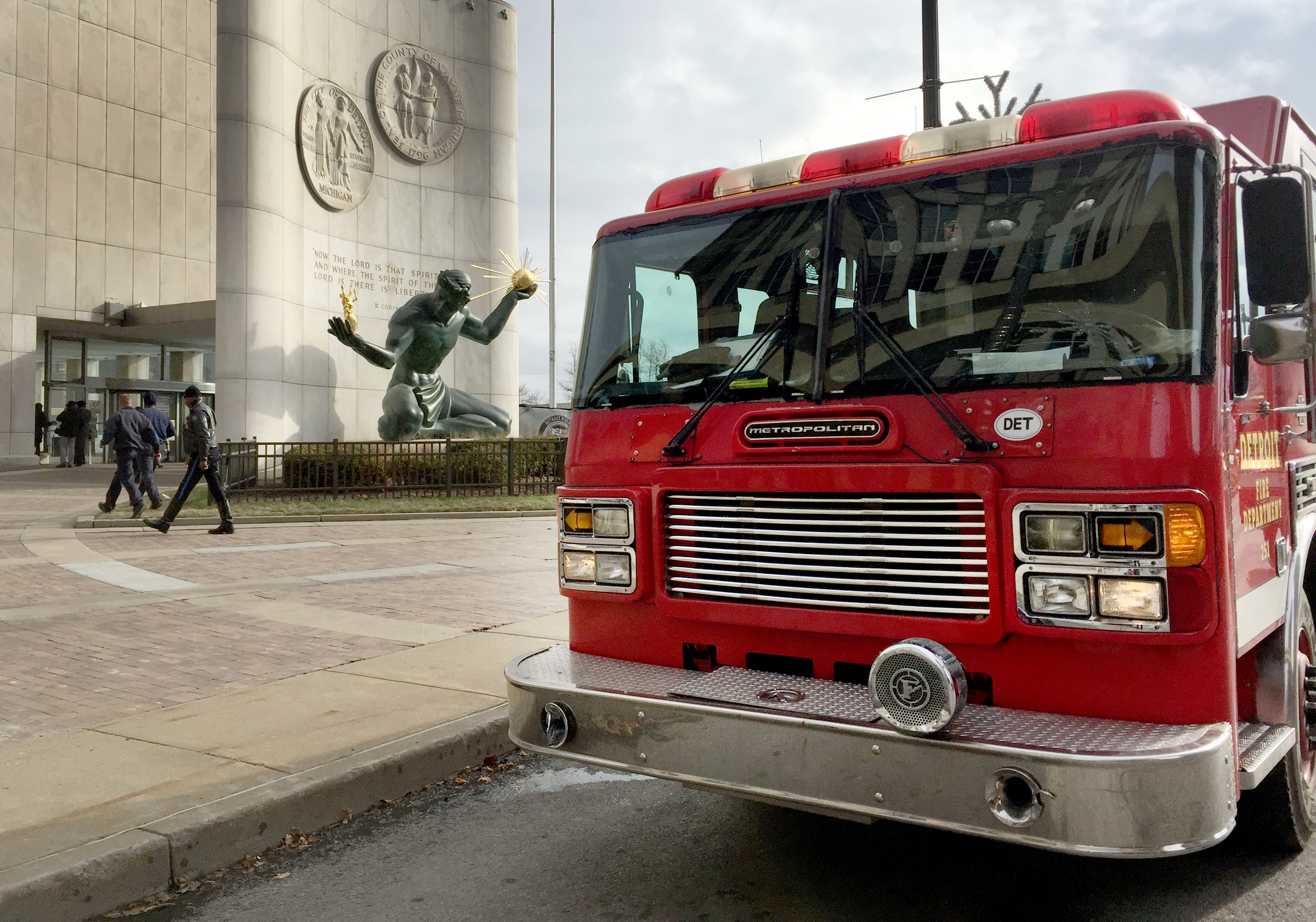 Detroit fire fighters and EMS responded to the Coleman A. Young Municipal Center to rescue people from elevators and assist others down the stairs after a massive power outage hit downtown Detroit, Tuesday, Dec. 2, 2014.