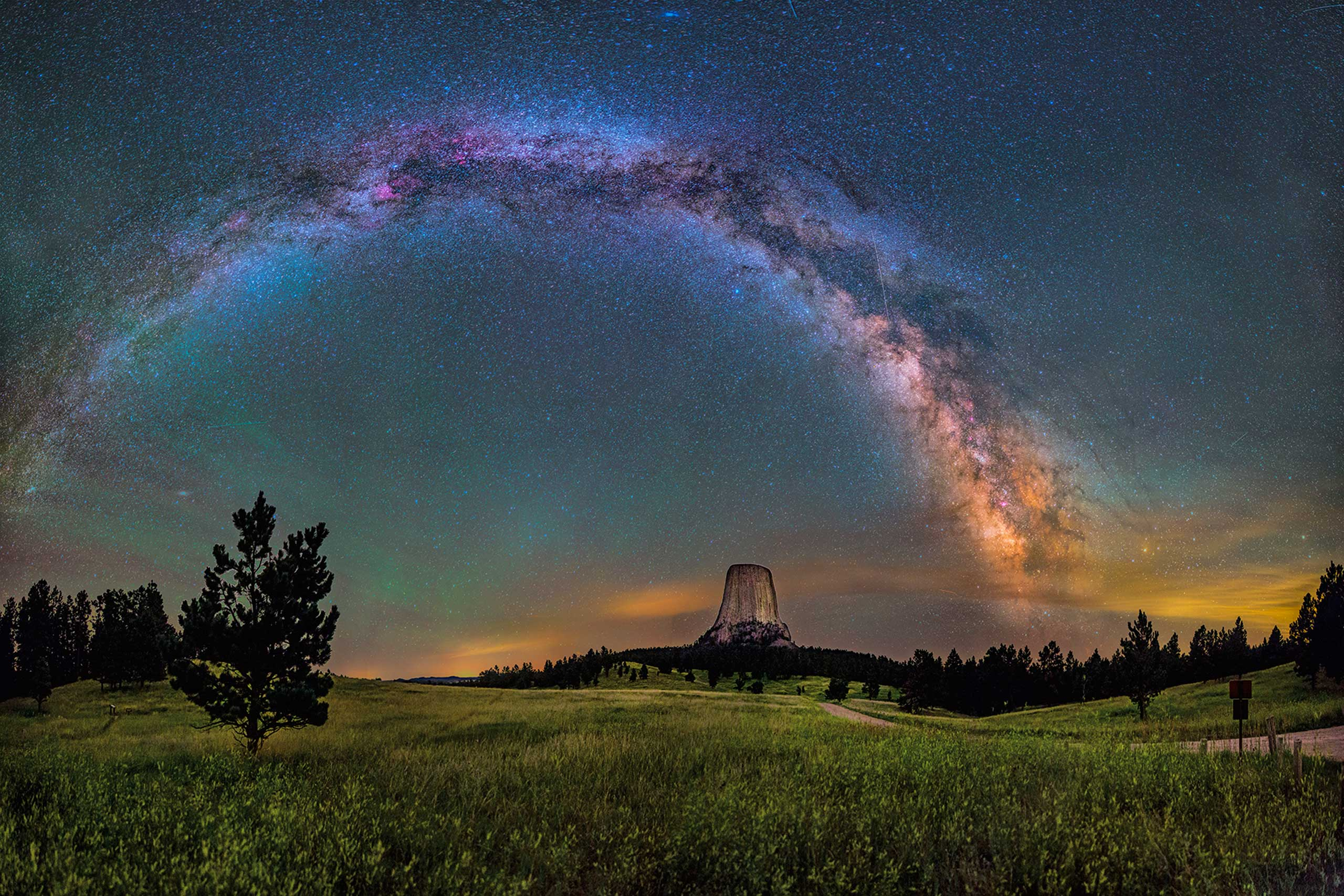 America's first national monument, Devils Tower is a geologic feature that protrudes out of the rolling prairie in Wyoming. David Lane (@drlane56) captured this amazing 16-image panorama of the monument illuminated by the Milky Way and green airglow. Of visiting Devils Tower, David says:  From ancient stories of the Pleiades taking refuge at the top to the generations of Native Americas that held it sacred, it had a deep sense of age and a stoic nature that impressed me. It's so unexpected, so large in person, so steeped in traditions.