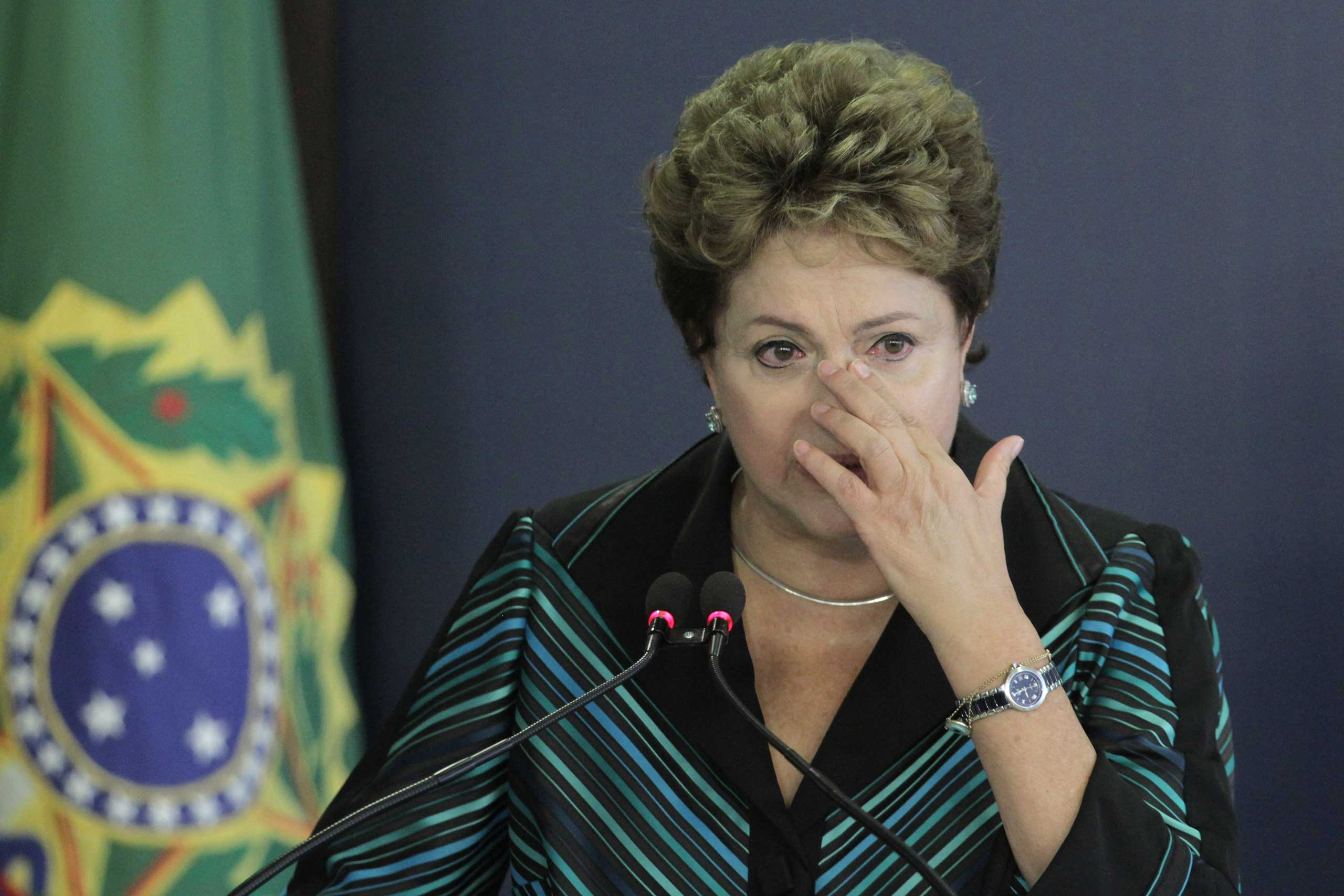 Brazil's President Dilma Rousseff cries during a speech at the launching ceremony of the National Truth Commission Report, at the Planalto Presidential Palace, in Brasilia, Brazil, Dec. 10, 2014.