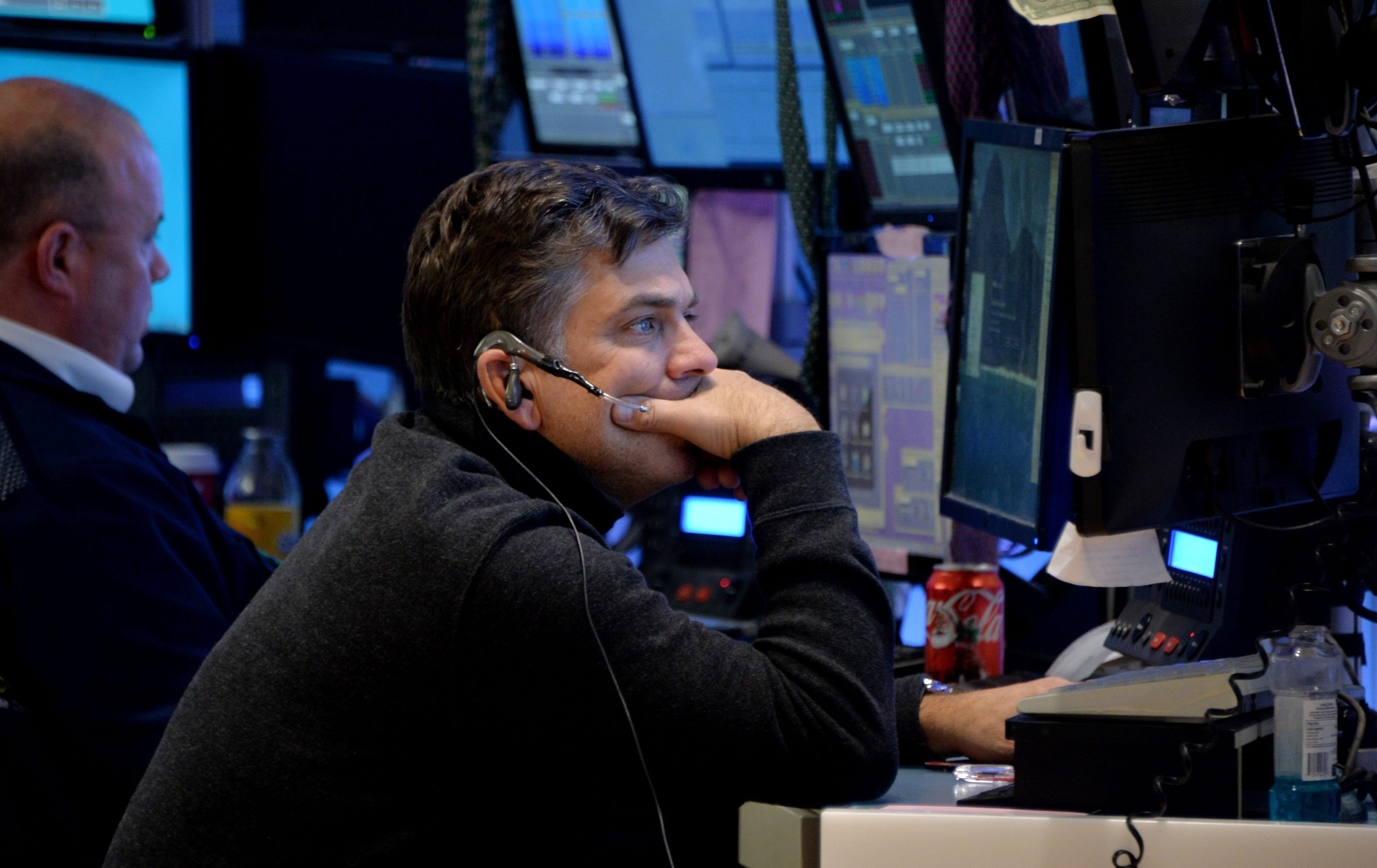 A trader works on the floor of the New York Stock Exchange at the end of the trading day in New York on Dec. 12, 2014.
