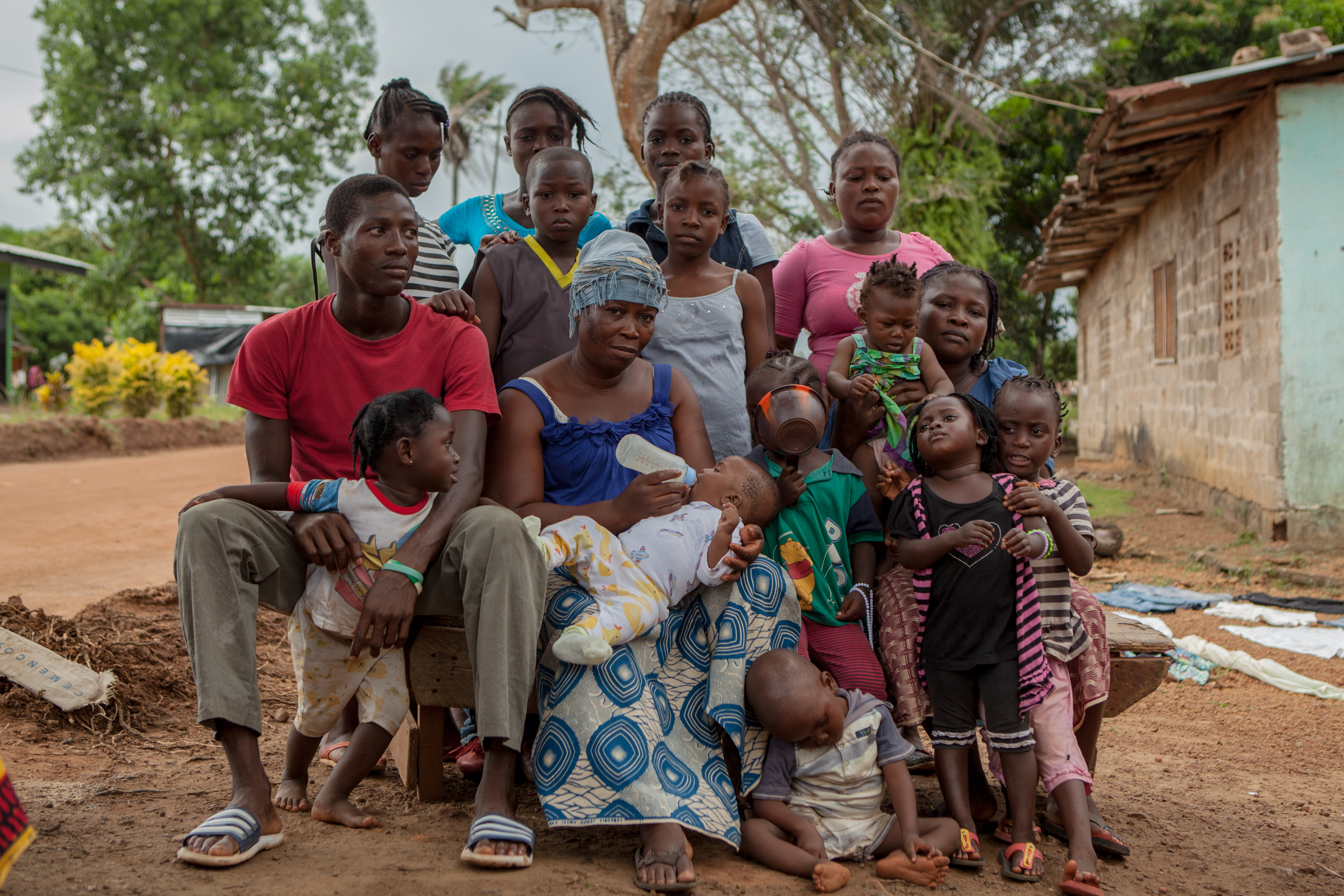 Dudu Kromah's husband died from Ebola. She is looking after ten children, many of them orphans including a 3-month-old baby. She has no income.