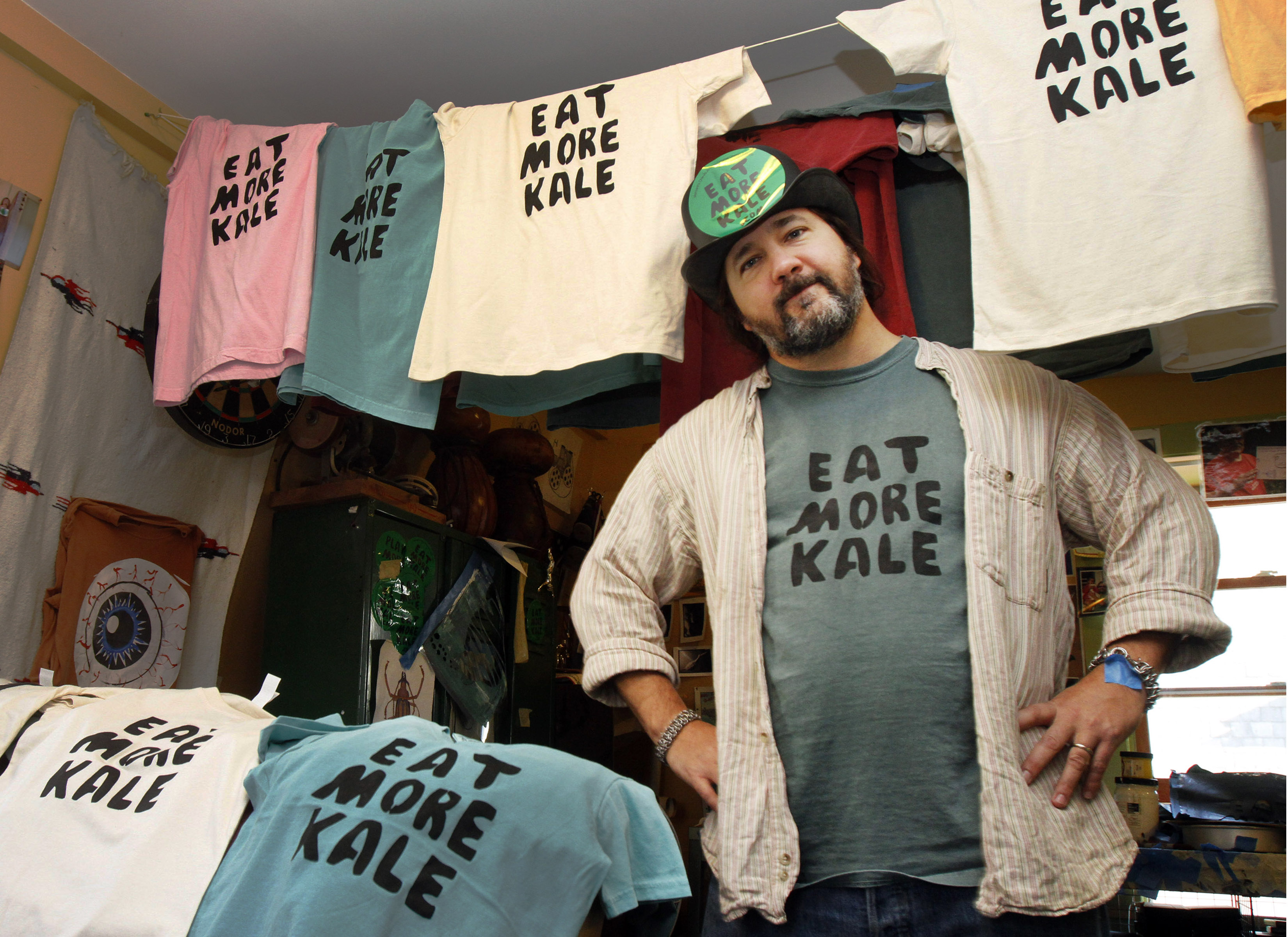 Bo Muller-Moore stands in his home studio in Montpelier, Vt. Muller-Moore, the Vermont man who is building a business around the term  eat more kale,  which has been plastered on T-shirts, bumper stickers and other items, is running into opposition from the second largest fried chicken retailer in the country, Chick-fil-A, on Nov. 22, 2011.