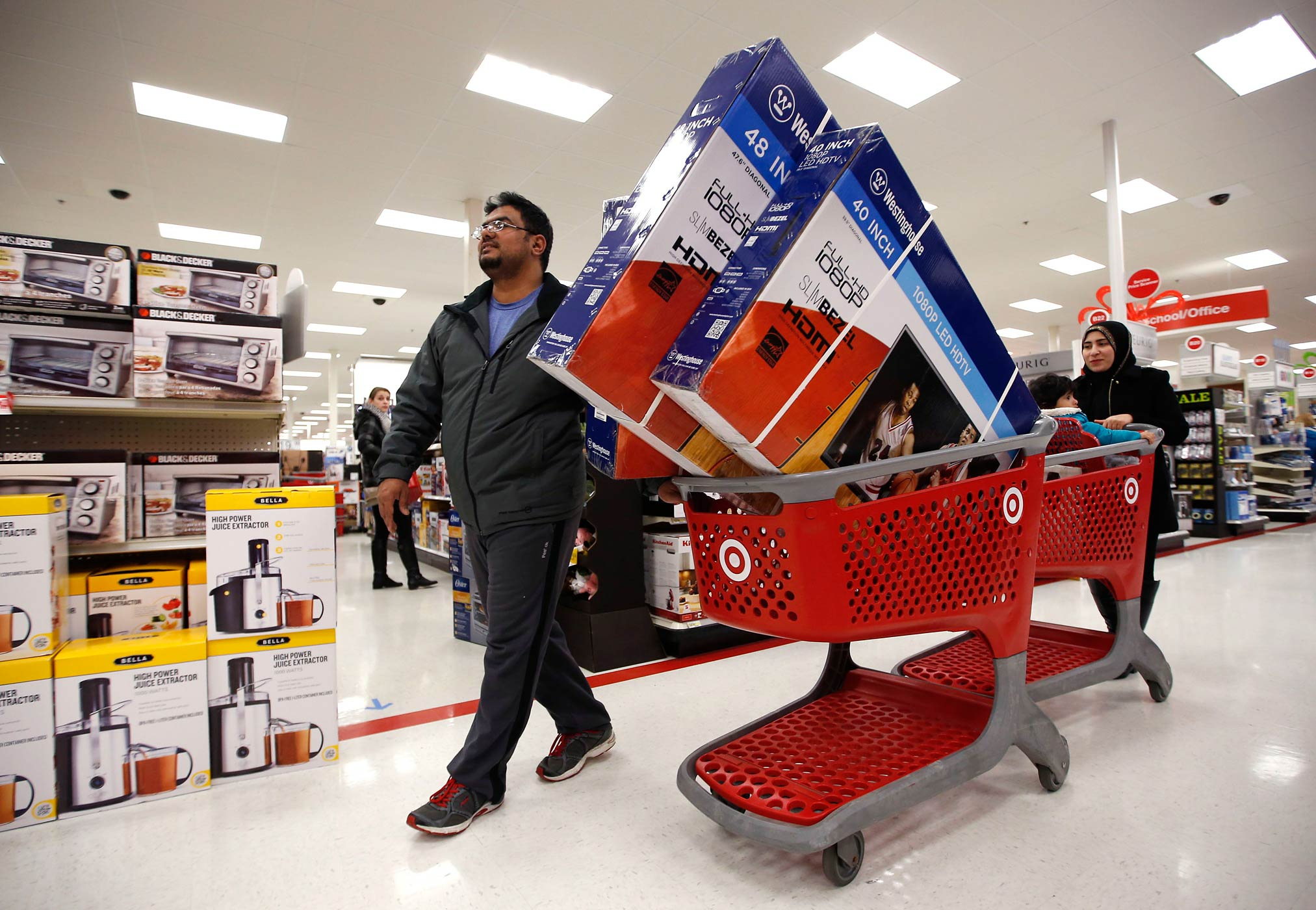 Shoppers patronize a Target store just after midnight on Black Friday, Nov. 28, 2014, in South Portland, Maine.