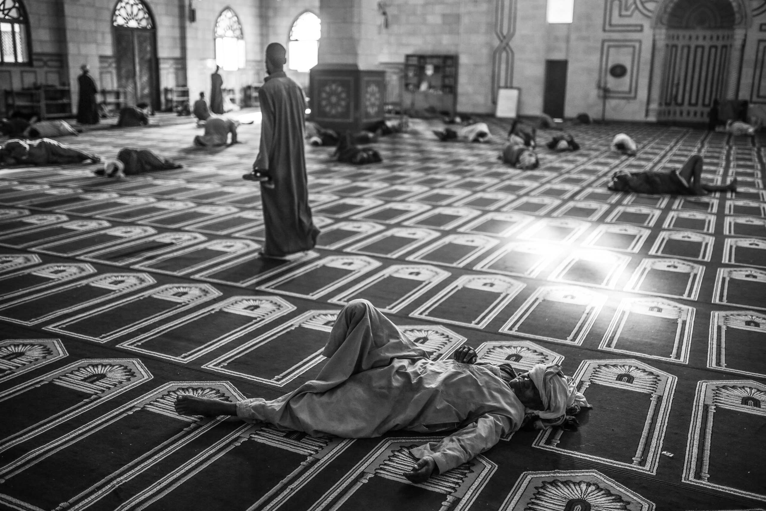 Worshippers take an early morning rest at the Abul-Hassan Al-Shazly mosque. Humaithara, Red Sea Governorate, Egypt. Oct. 1, 2014.