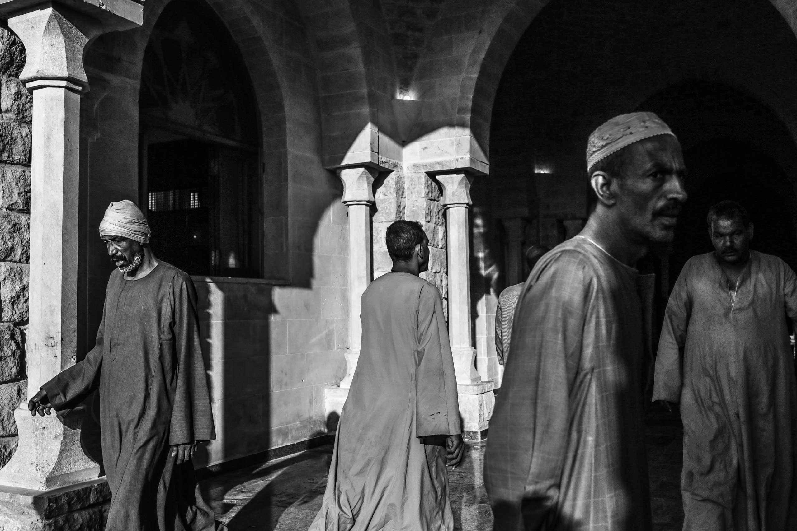 Attendees walk outside the Abul-Hassan Al-Shazly mosque. Humaithara, Red Sea Governorate, Egypt. Oct. 1, 2014.