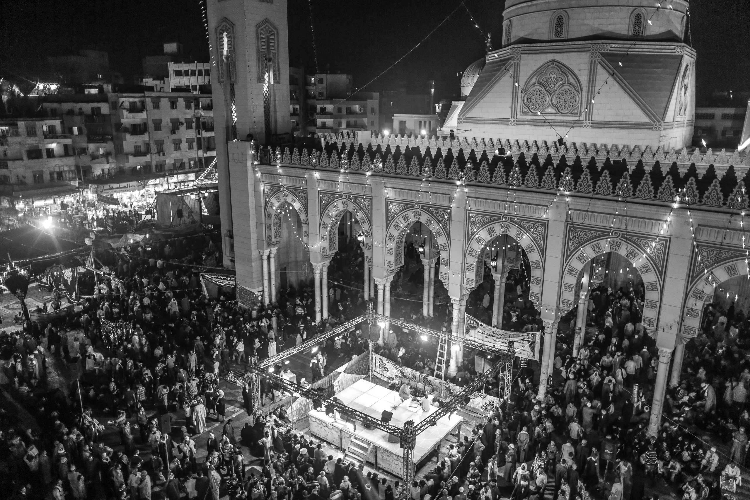 Attendees of celebration for El-Sayed El-Badawi are seen outside his mosque. Tanta, Egypt. Oct. 16, 2014.