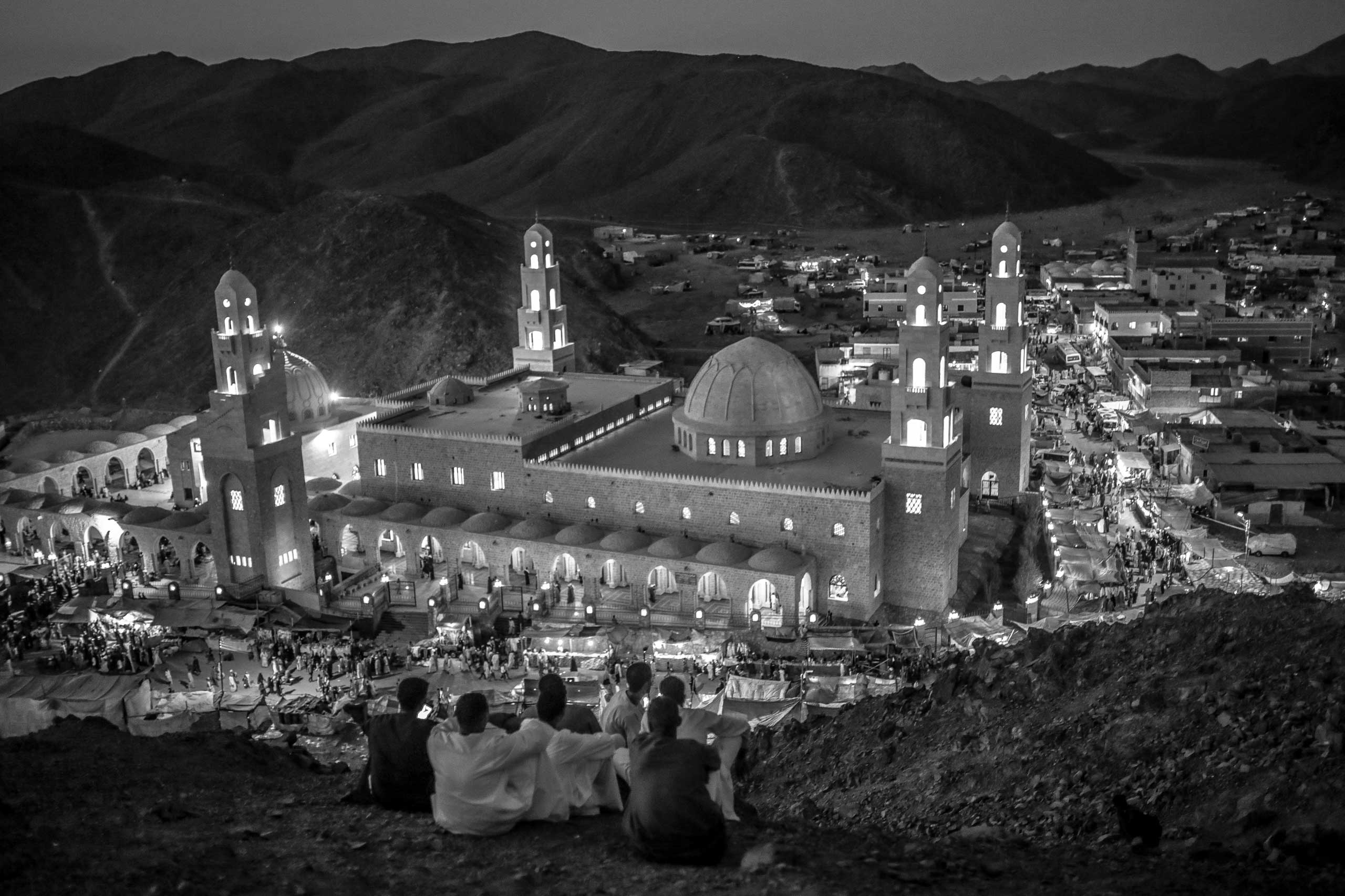 Worshippers look onto the mosque of Abul-Hassan Al-Shazly during the annual celebration of his birth. Humaithara, Red Sea Governorate, Egypt. Sept, 30, 2014.