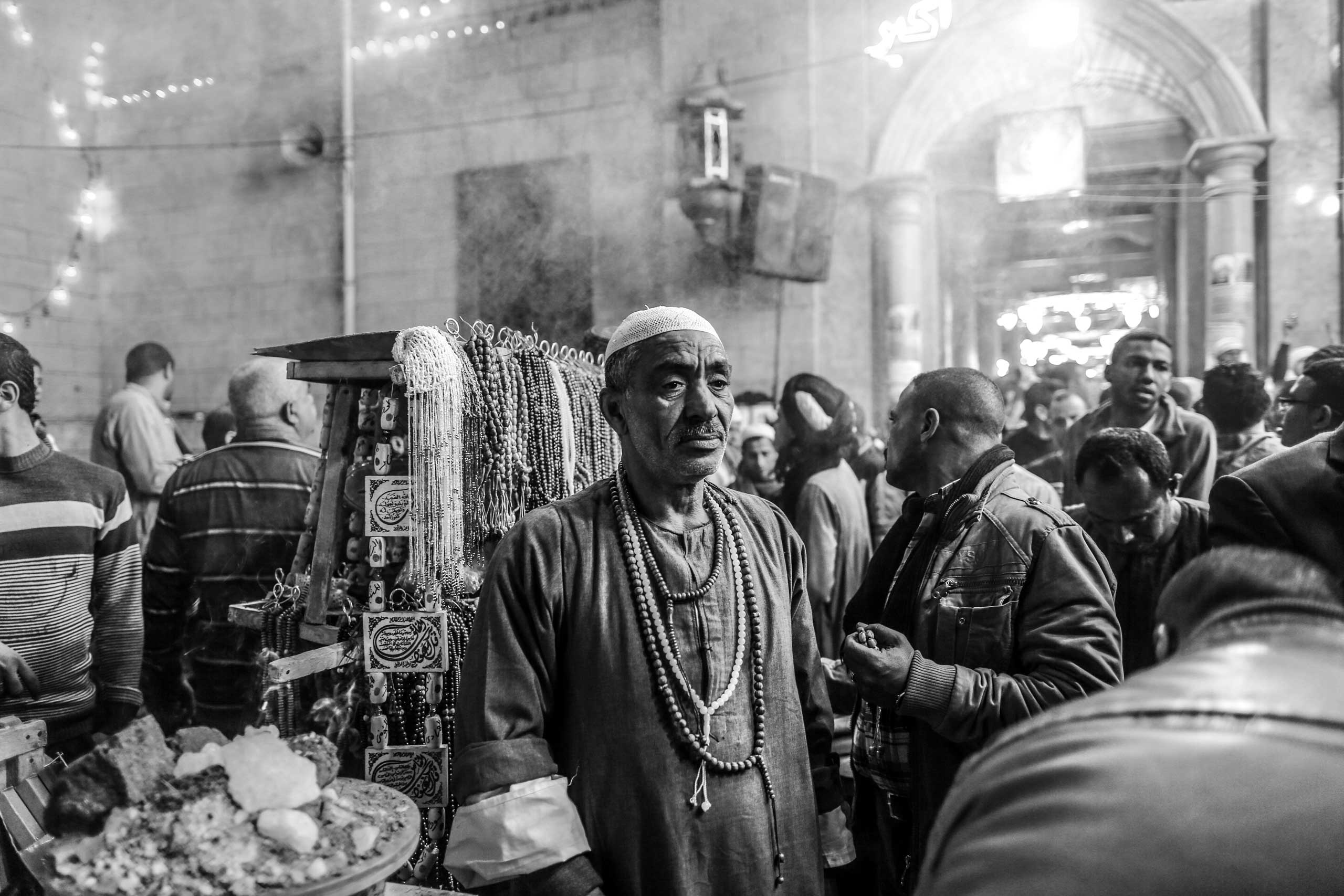 A merchant stands the mosque of Al-Hussein, the grandson of the Prophet Muhammad. Downtown Cairo, Egypt. Feb. 25, 2014.