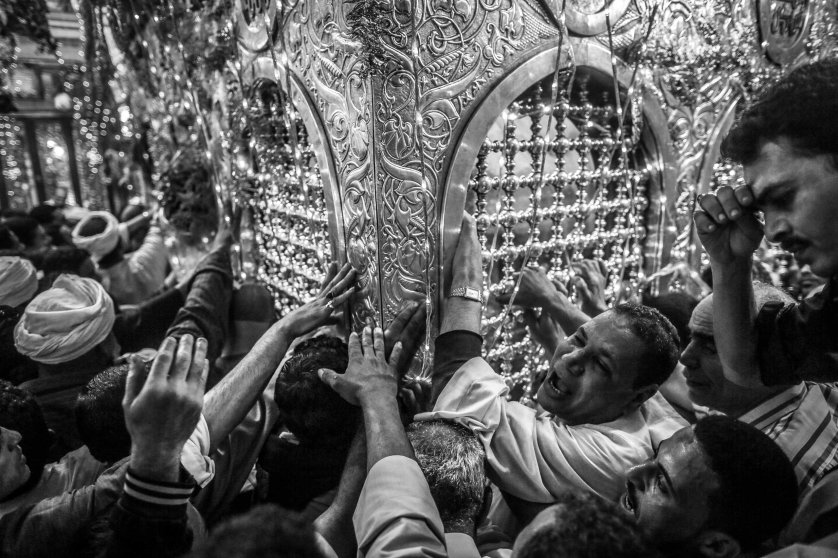 Sufi Muslims surround the shrine of Sayeda Zeinab, the grand daughter of Prophet Muhammed in Cairo, during the annual Mawlid celebrating her birthday. May 20, 2014.
