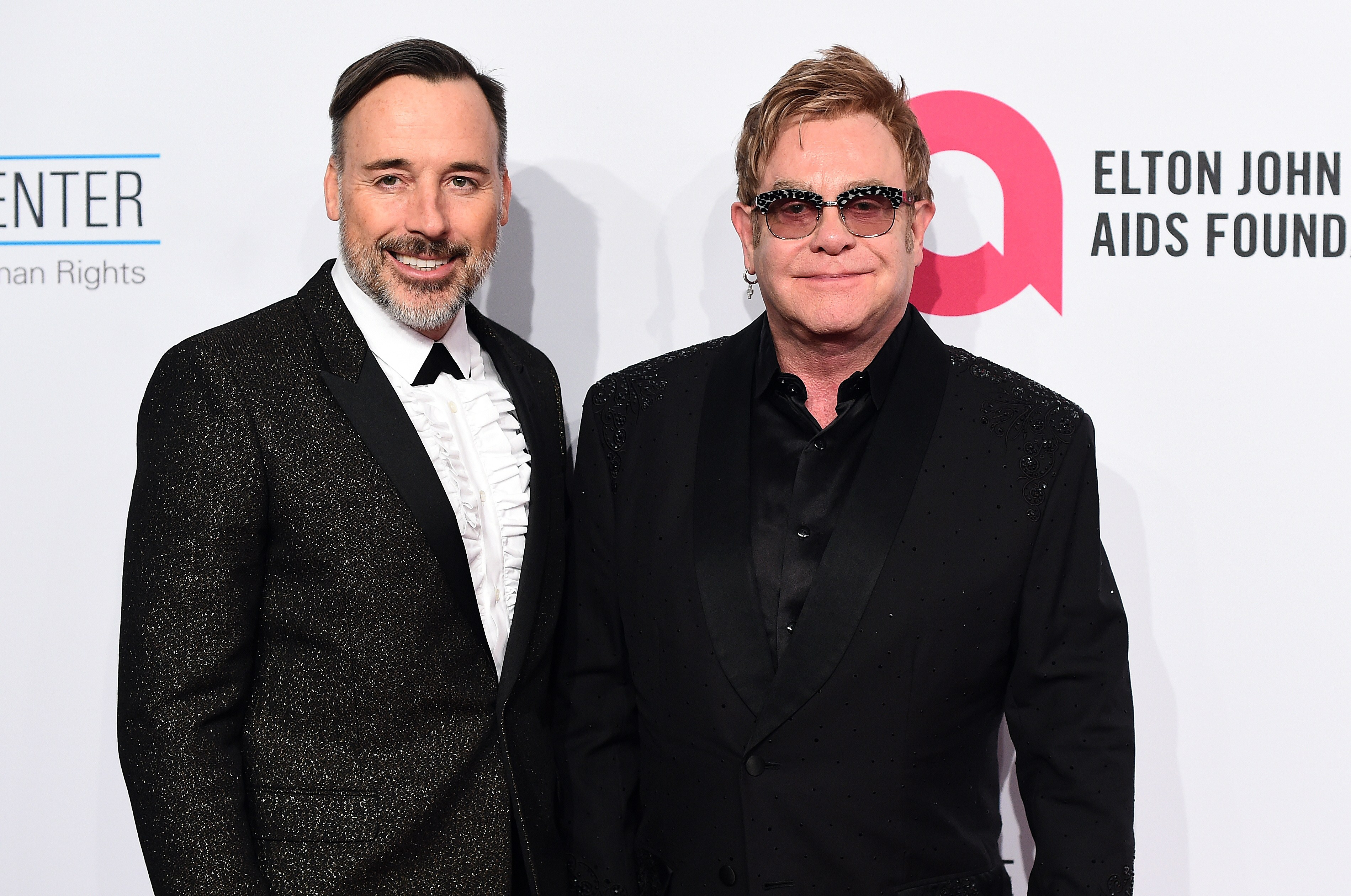 Film maker David Furnish and musician Sir Elton John arrive to attend the Elton John AIDS Foundation's 13th Annual An Enduring Vision Benefit on Oct. 28, 2014 in New York.