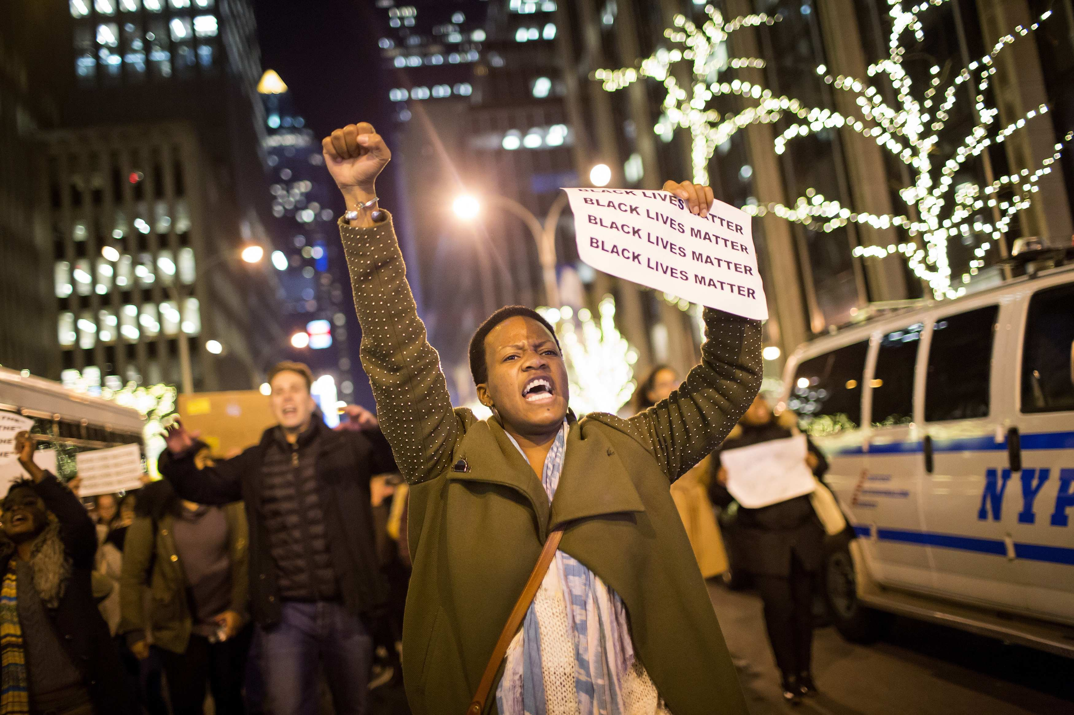 People take part in a protest against the grand jury decision on the death of Eric Garner in midtown Manhattan in New York on Dec. 3, 2014.
