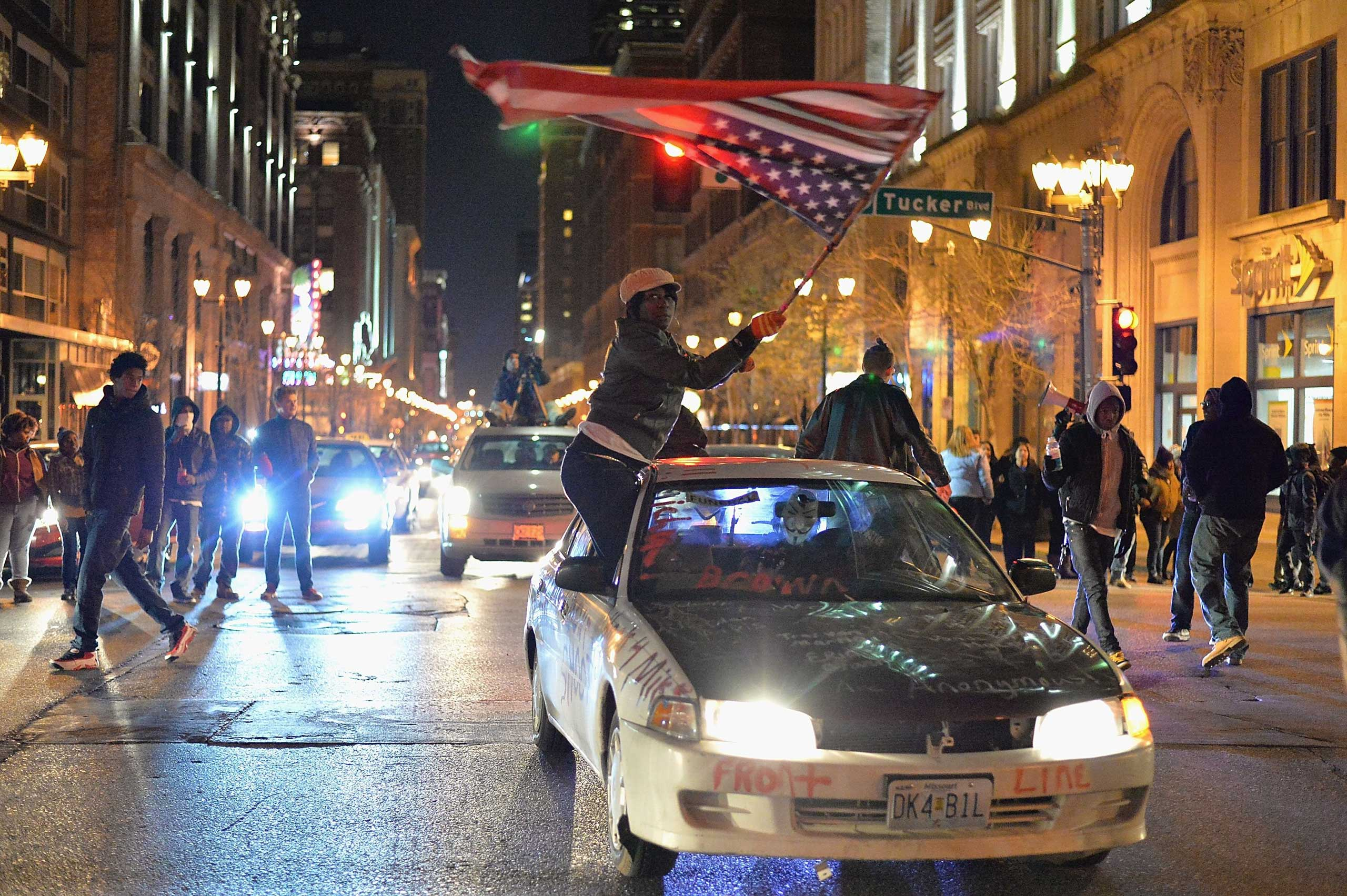 Demonstrators march in protest on the streets of St. Louis on Dec. 3, 2014.