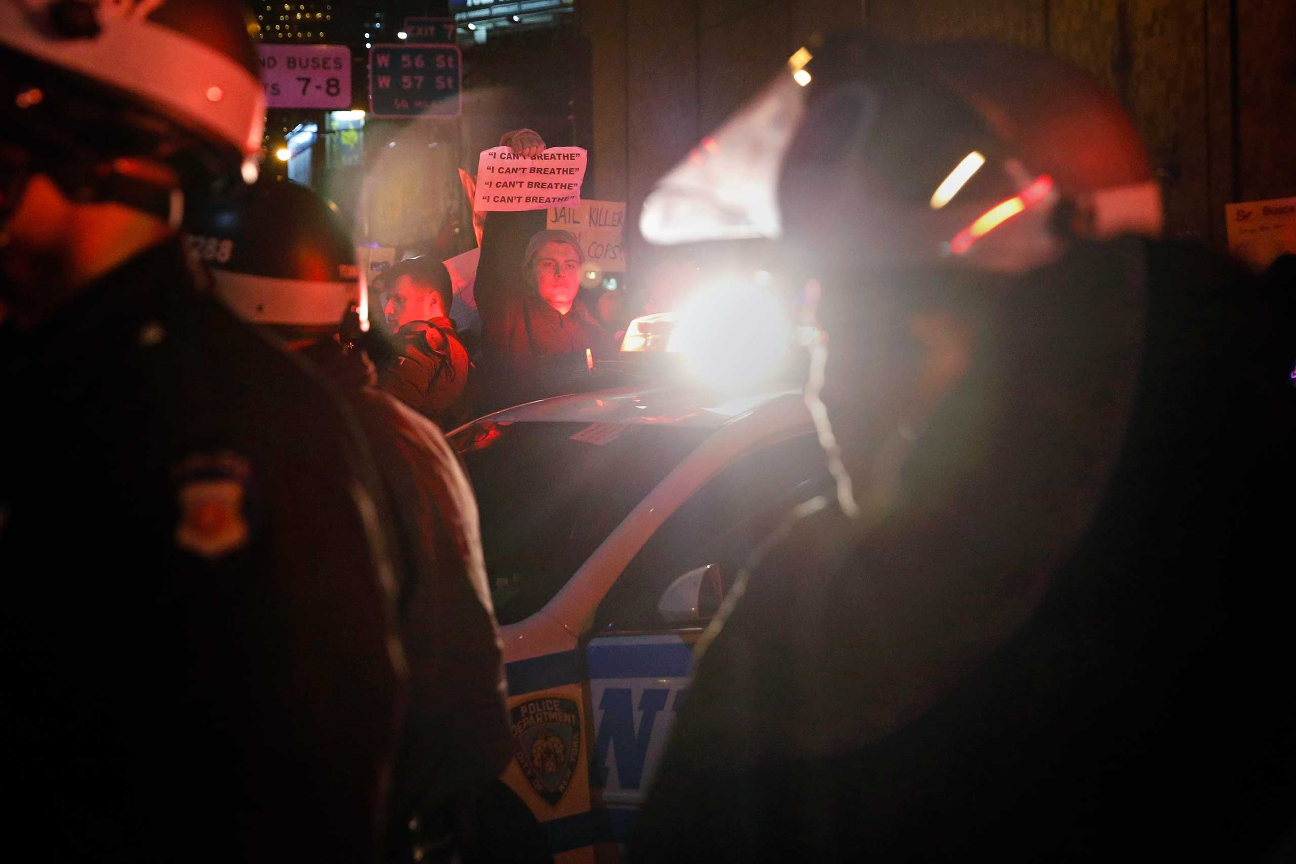 Police stand guard on the West Side highway as protesters block traffic in New York City on Dec. 3, 2014.