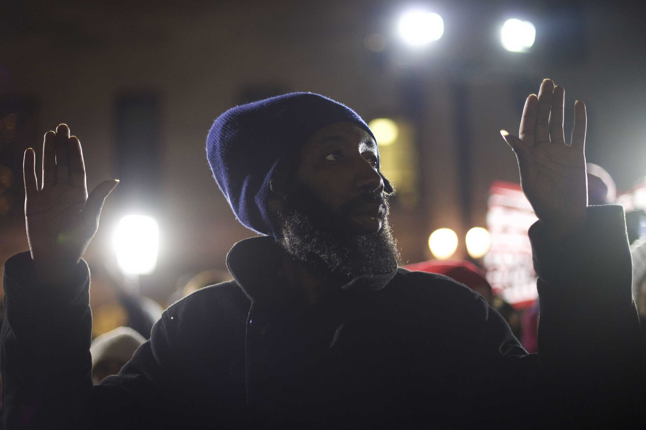 Anwar Thurston, 36, joined demonstrators who gathered to protest the Eric Garner grand jury decision during a Christmas Tree lighting ceremony at City Hall in Philadelphia on Dec. 3, 2014.
