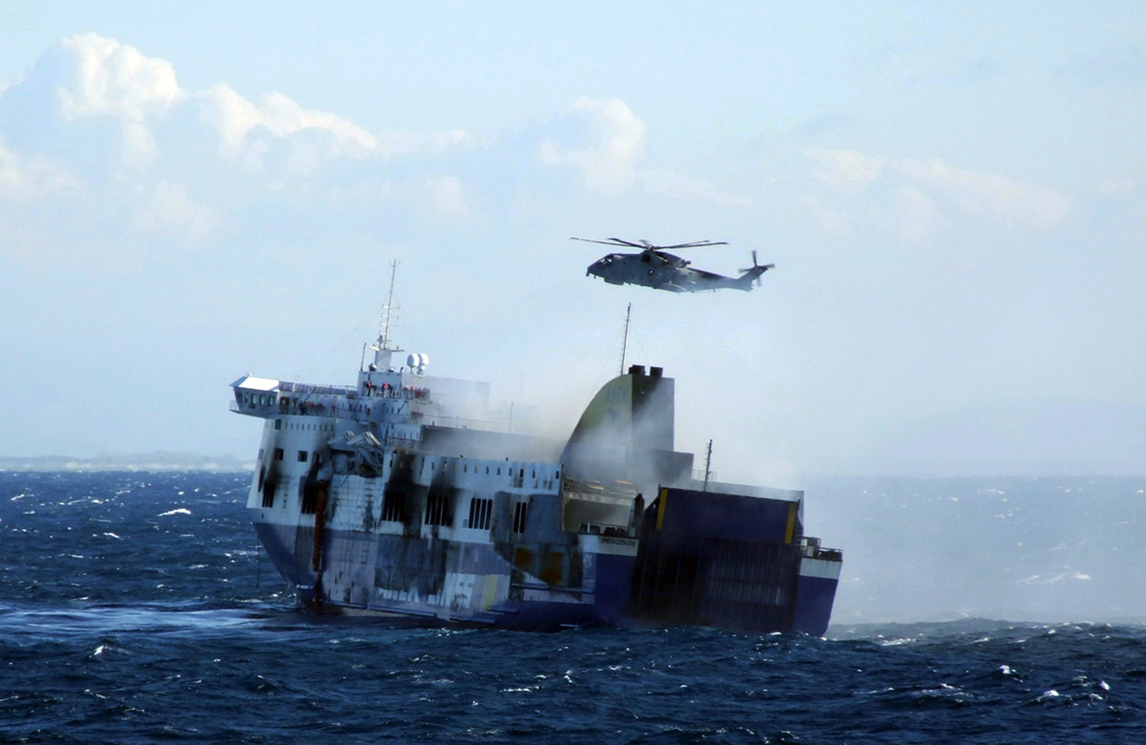 A rescue operation of the burned ferry  Norman Atlantic  adrift in the Adriatic Sea off Albania on Dec. 29, 2014.