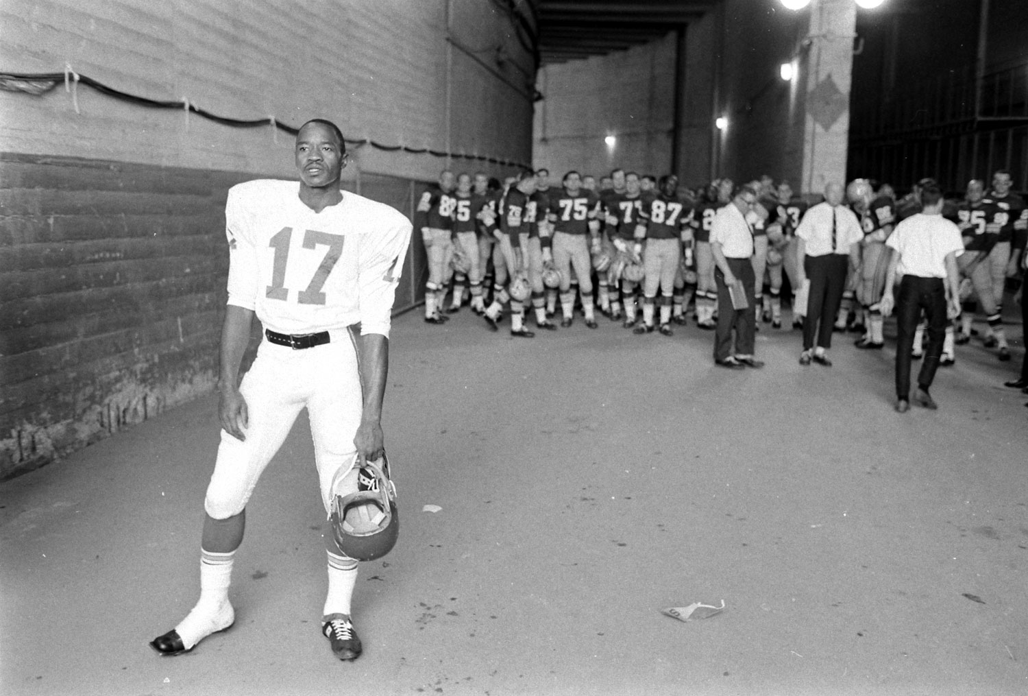 <b>Not published in LIFE.</b> Kansas City's Fletcher Smith, with the Green Bay Packers massed behind him, prior to the start of Super Bowl I, Los Angeles, 1967.