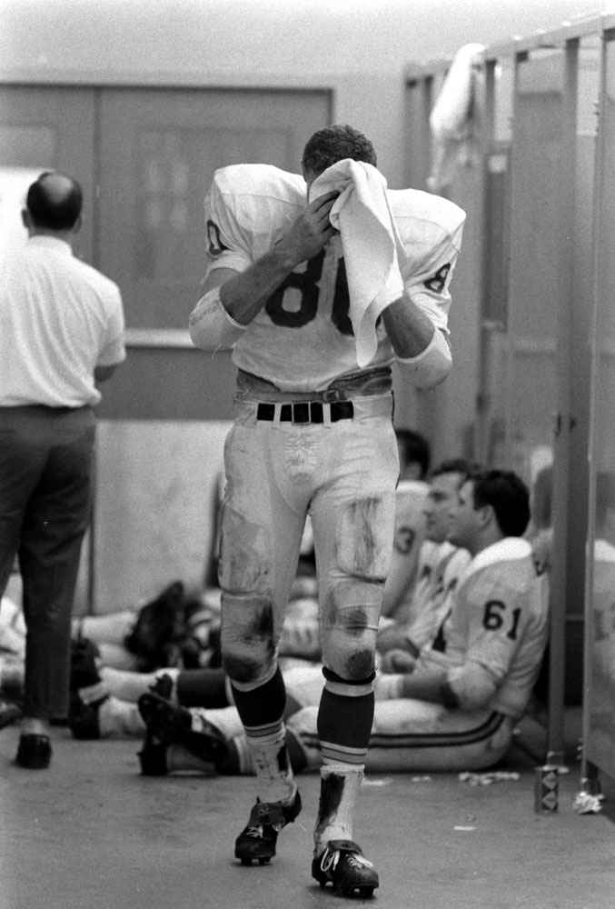 <b>Not published in LIFE.</b> Tight end Reggie Carolan in the Chiefs' locker room, Super Bowl I, 1967.