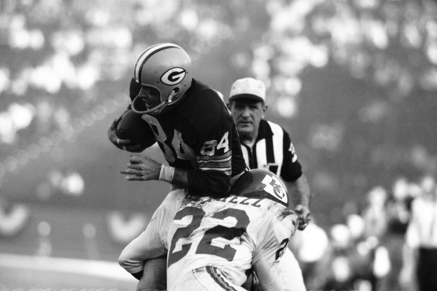 <b>Not published in LIFE.</b> Green Bay receiver Carroll Dale hit by the Chiefs' Willie Mitchell, Super Bowl I, 1967.