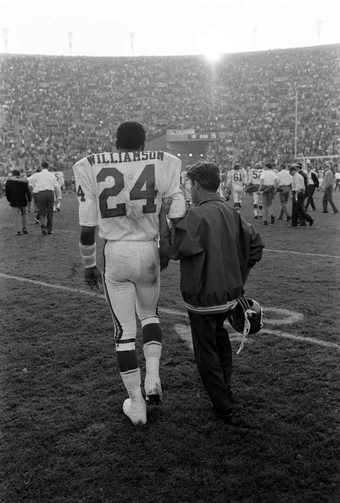 """<b>Not published in LIFE.</b> Fred """"The Hammer"""" Williamson led from the field at the end of the first Super Bowl, 1967. Williamson broke his arm during the game."""