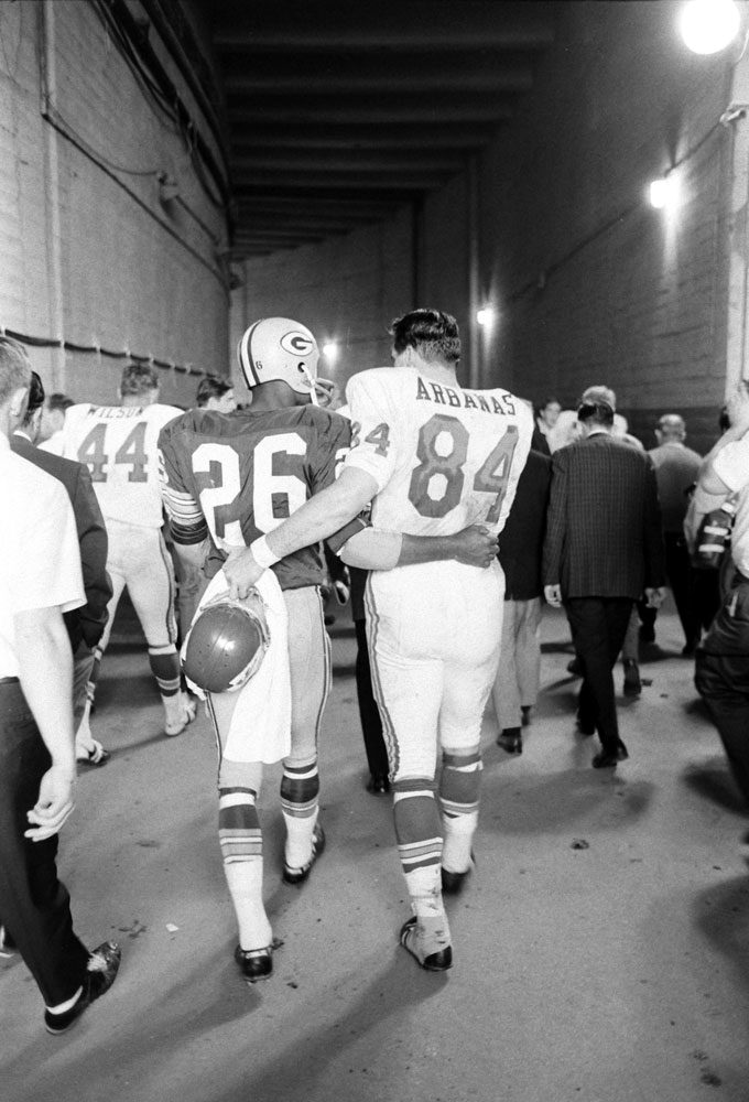 <b>Not published in LIFE.</b> The Packers' Herb Adderley and Kansas City's tight end Fred Arbanas head to the lockers after Green Bay's 35-10 victory in Super Bowl I, Los Angeles, 1967.