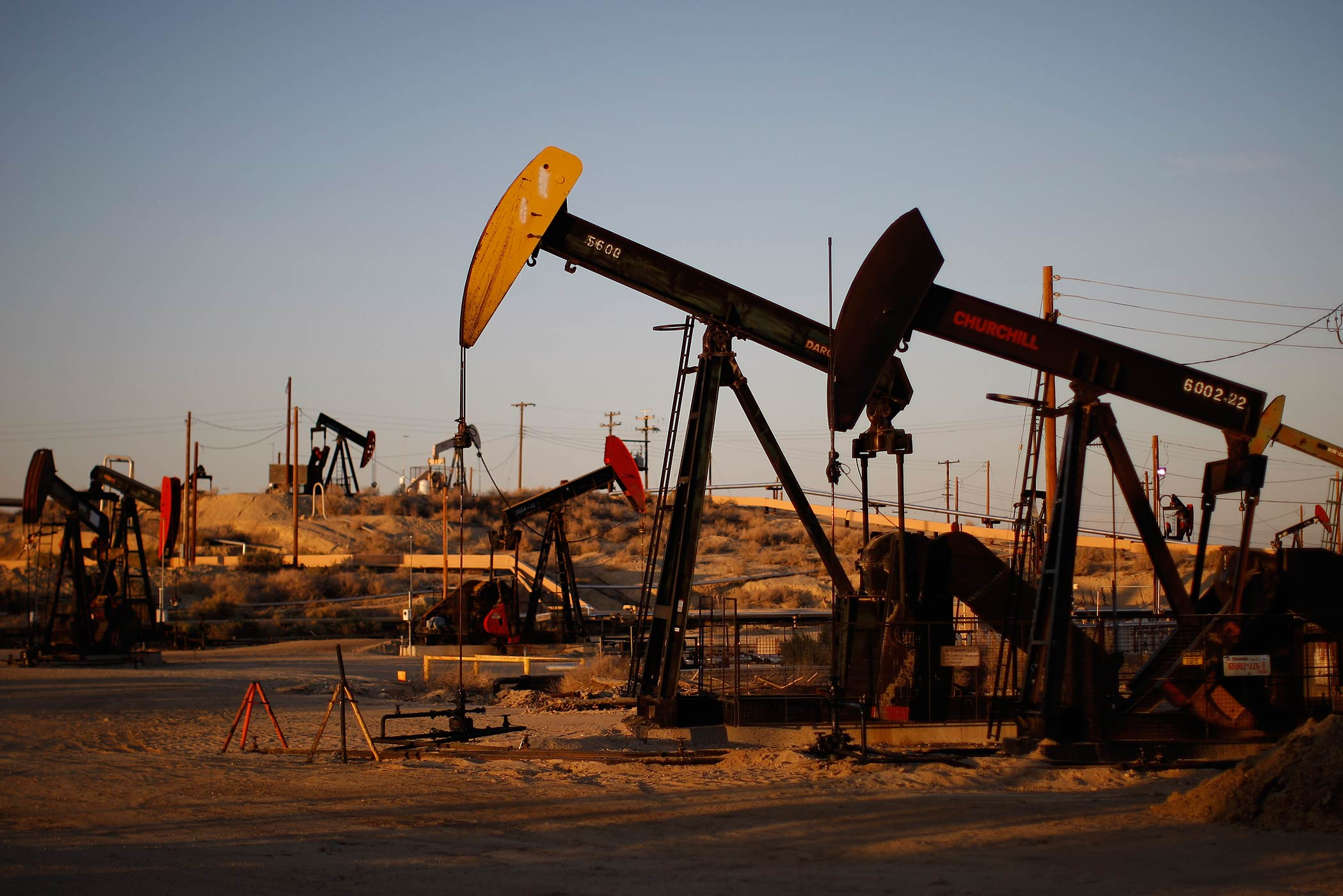 Pump jacks and wells are seen in an oil field that uses fracking on the Monterey Shale formation near McKittrick, Ca. on March 23, 2014.