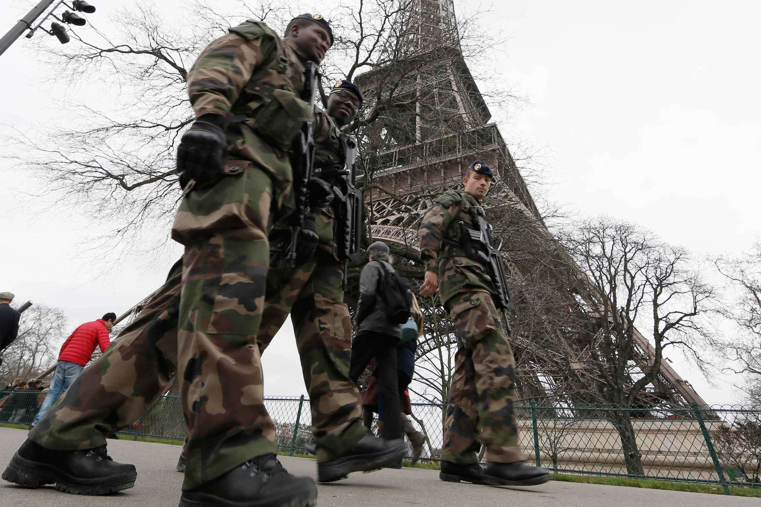 French soldiers patrol near the Eiffel Tower in Paris as part of the  Vigipirate  security plan on Dec. 23, 2014.