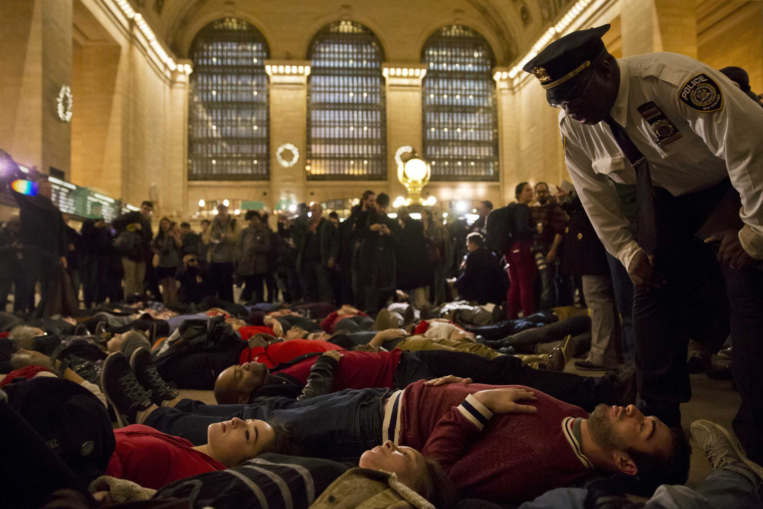 United States: Protests over the grand jury's decision not to bring charges in the death of Eric Garner A 'die-in' in New York's Grand Central Terminal, Dec. 3, 2014.